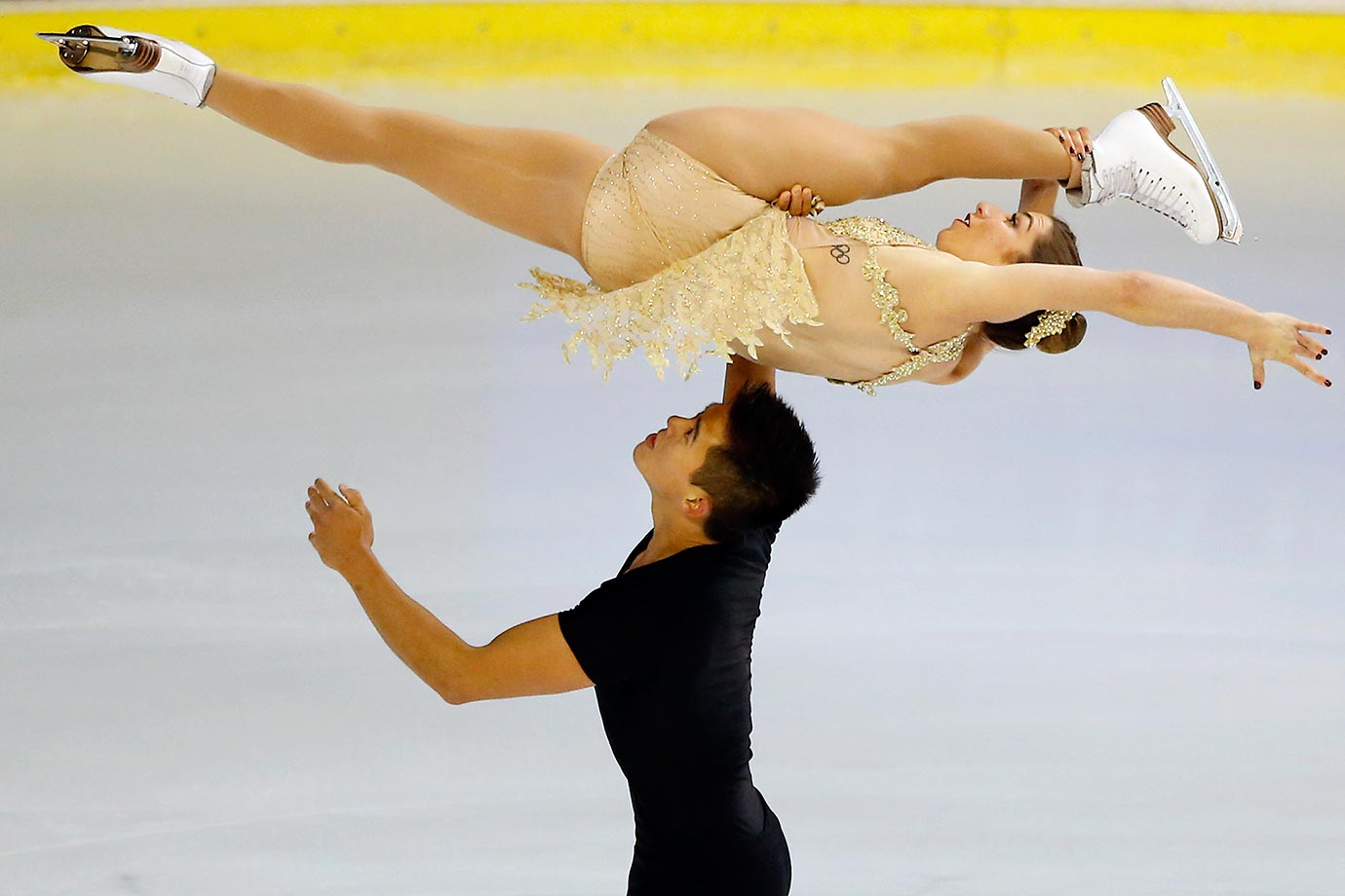 Marissa Castelli and Mervin Tran compete in the Pairs Short Program at the ISU figure skating Eric Bompard Trophy competition in France.