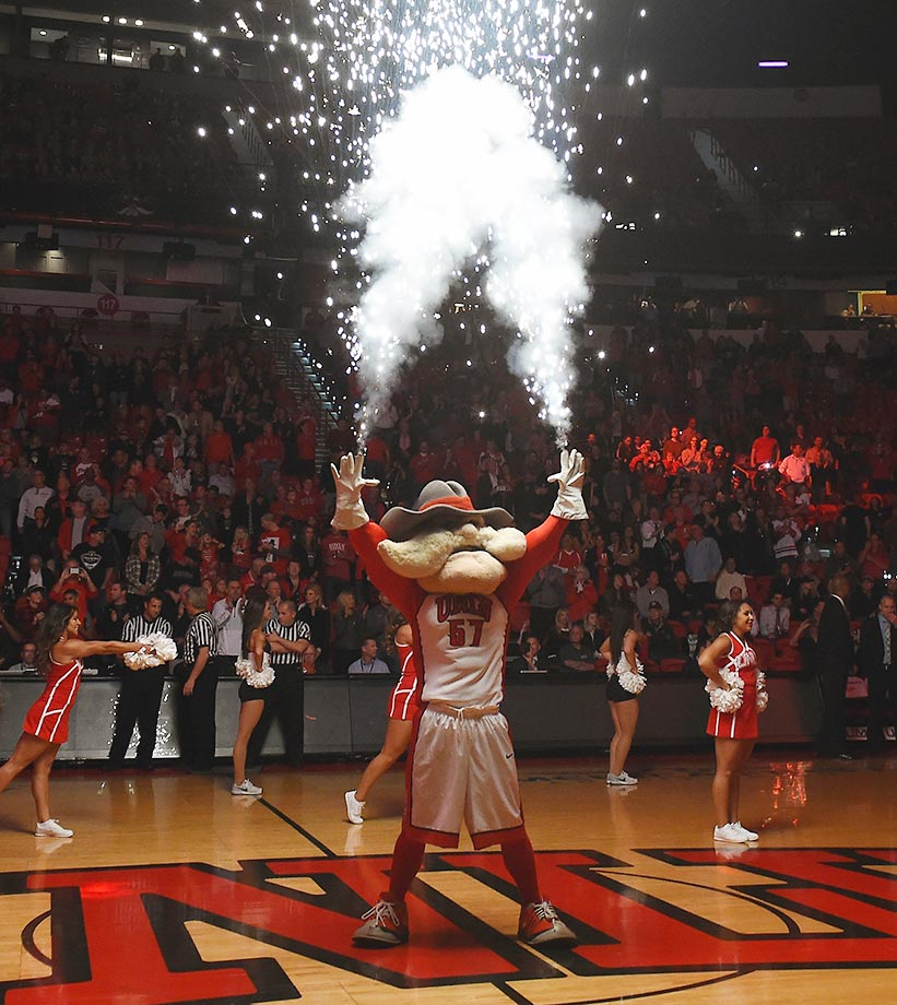 Pyrotechnics shoot from the hands of Hey Reb, the UNLV Rebels mascot, before a game against Cal Poly.