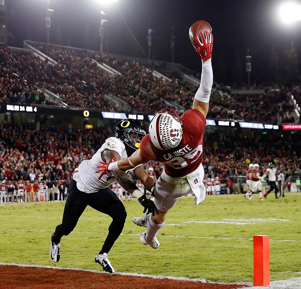 Devon Cajuste of Stanford makes a one-handed catch against Ugo Amadi of Oregon. Cajuste was ruled out-of-bounds on the play, but Amadi was called for pass interference.