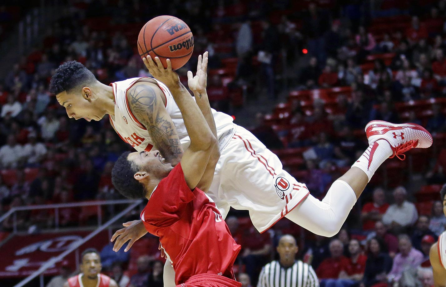 Kyle Kuzma of Utah fouls Trey Kennedy of Southern Utah.