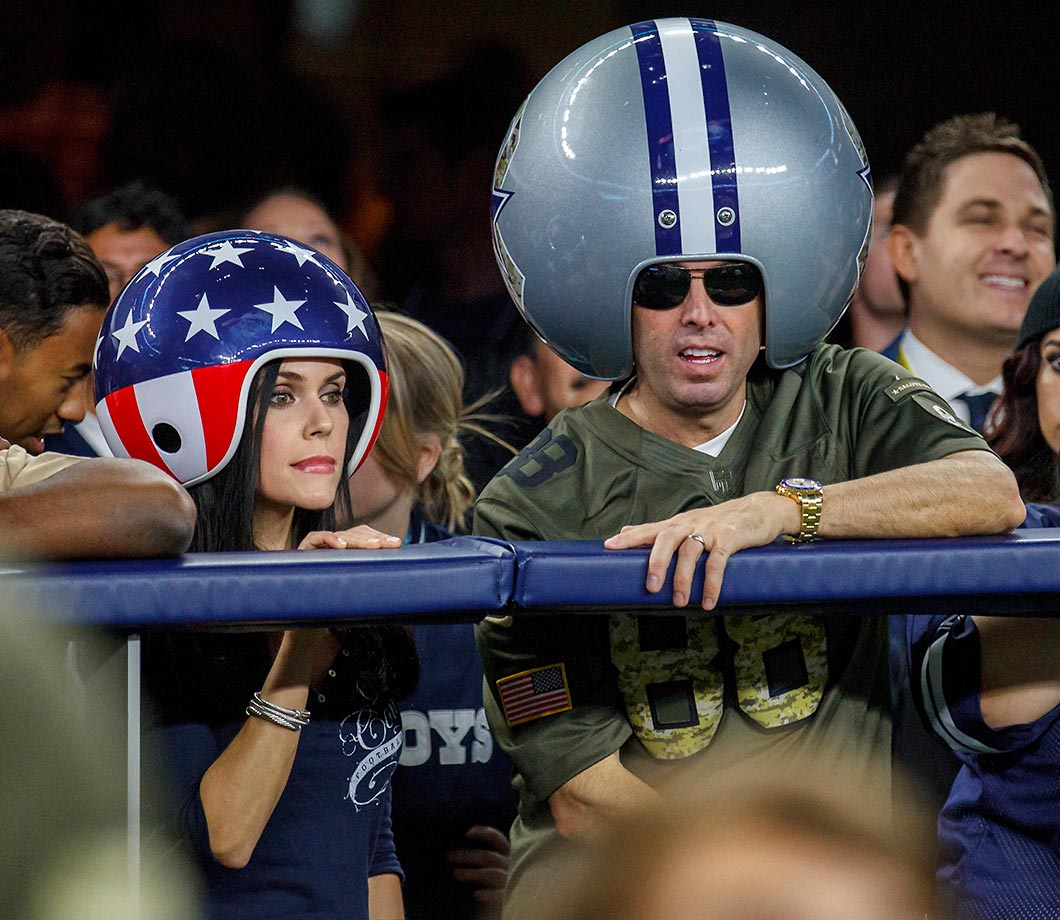 Looks like our friendly Dallas Cowboys helmet head fan from years past now has a partner.
