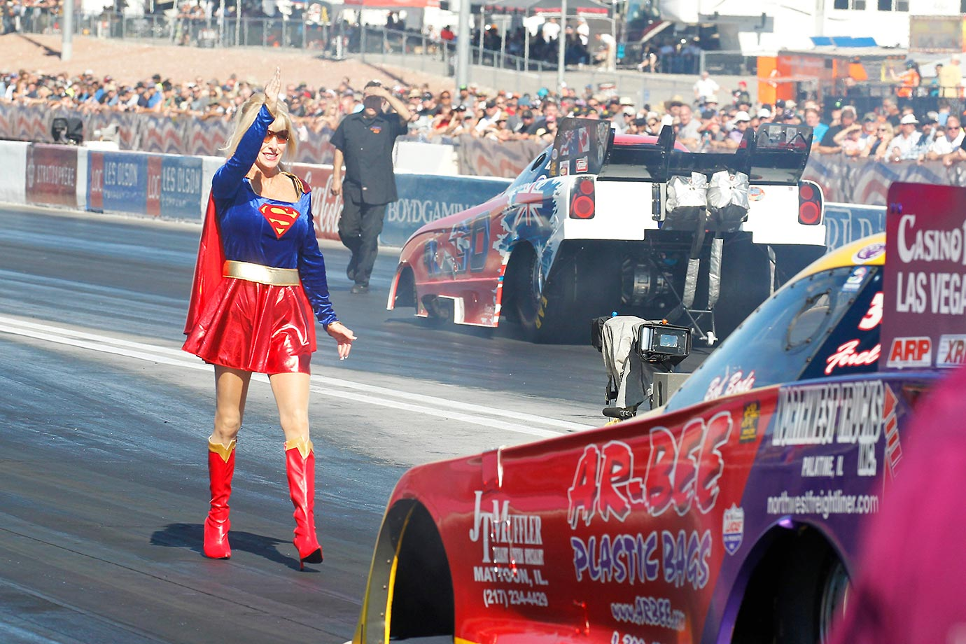Superwoman backs up Bob Bode at the NHRA Funny Car 15th Annual Toyota Nationals in Las Vegas.