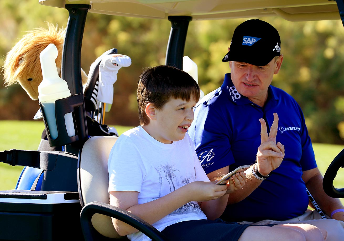 That was only two shots.... Ernie Els with his son Ben at the SAP Invitational Golf Day at Dragon Ridge Country Club in Las Vegas.