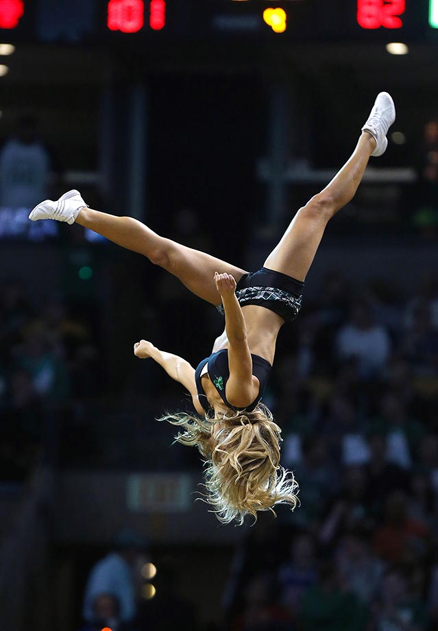 A Boston Celtics dancer performs a flip at a game against the 76ers in Boston.
