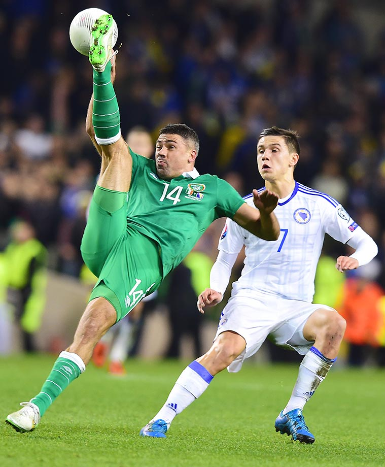 Jon Walters of Ireland stretches for a kick against Muhamed Besic of Bosnia-Herzegovina.