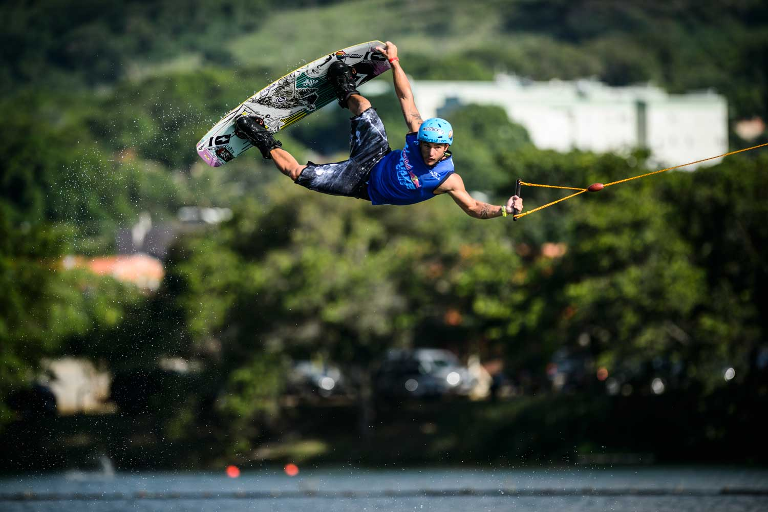 A professional wakeboarder practicing tricks on the open water.