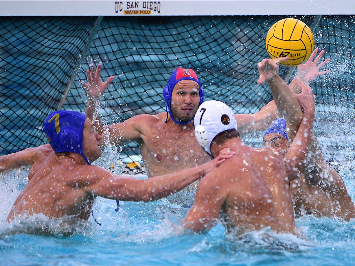 The UCLA defense collapses on Mihajlo Milicevic of USC.