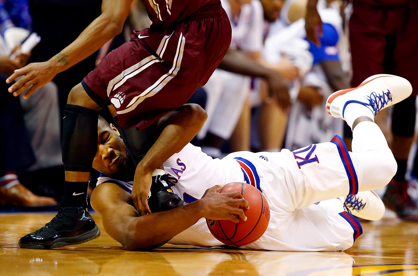 Wayne Selden Jr. of the Kansas Jayhawks dives for a loose ball against the Montana Grizzlies.