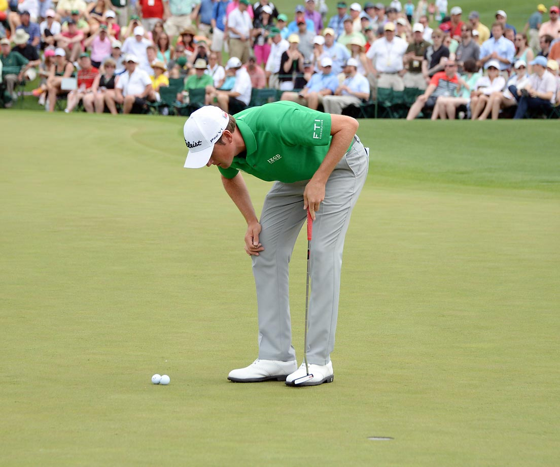 Webb Simpson looks a little puzzled at the second hole of the final round of the Masters.  The second ball belongs Noh Seung-Yul.