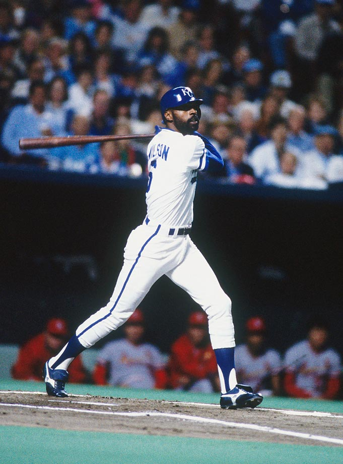 Willie Wilson bats against the Cardinals. The outfielder hit .367 in the World Series.