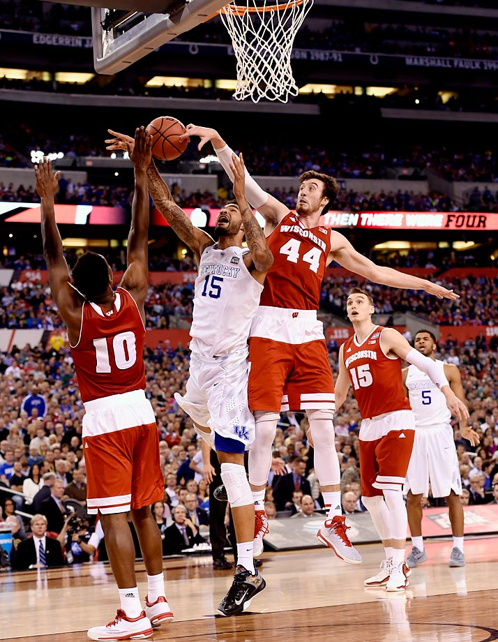 Kentucky entered the season No. 1 and didn't relinquish that perch until March. The Wildcats finished the regular season 31-0, then swept through the SEC tournament to enter the NCAA tournament 34-0. But in the Final Four, Kentucky met Wisconsin, and the fellow-top-seeded Badgers, who pulled off the upset, 71-64, behind 20 points from consensus player of the year Frank Kaminsky. After the season, seven Wildcats players, including freshman star Karl-Anthony Towns, announced they were turning pro.                                          (Text credit: Alex Putterman/SI.com)