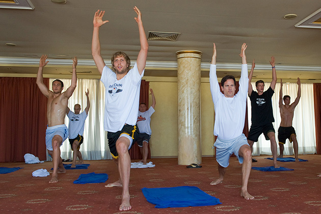 Kent Katich leads a class of athletes in a yoga session, including Dallas Mavericks star Dirk Nowitzki (left).