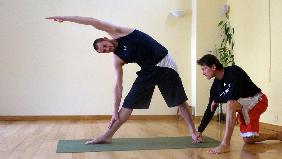 Yoga instructor Kent Katich goes through a workout with NBA star Kevin Love.