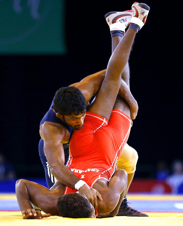 Yogeshwar Dutt of India, left, wrestles with Chamara Perera of Sri Lanka during a men's FS 65kg semifinal wrestling bout at the Scottish Exhibition Conference Centre during the Commonwealth Games 2014 in Glasgow, Scotland, Thursday July 31, 2014.