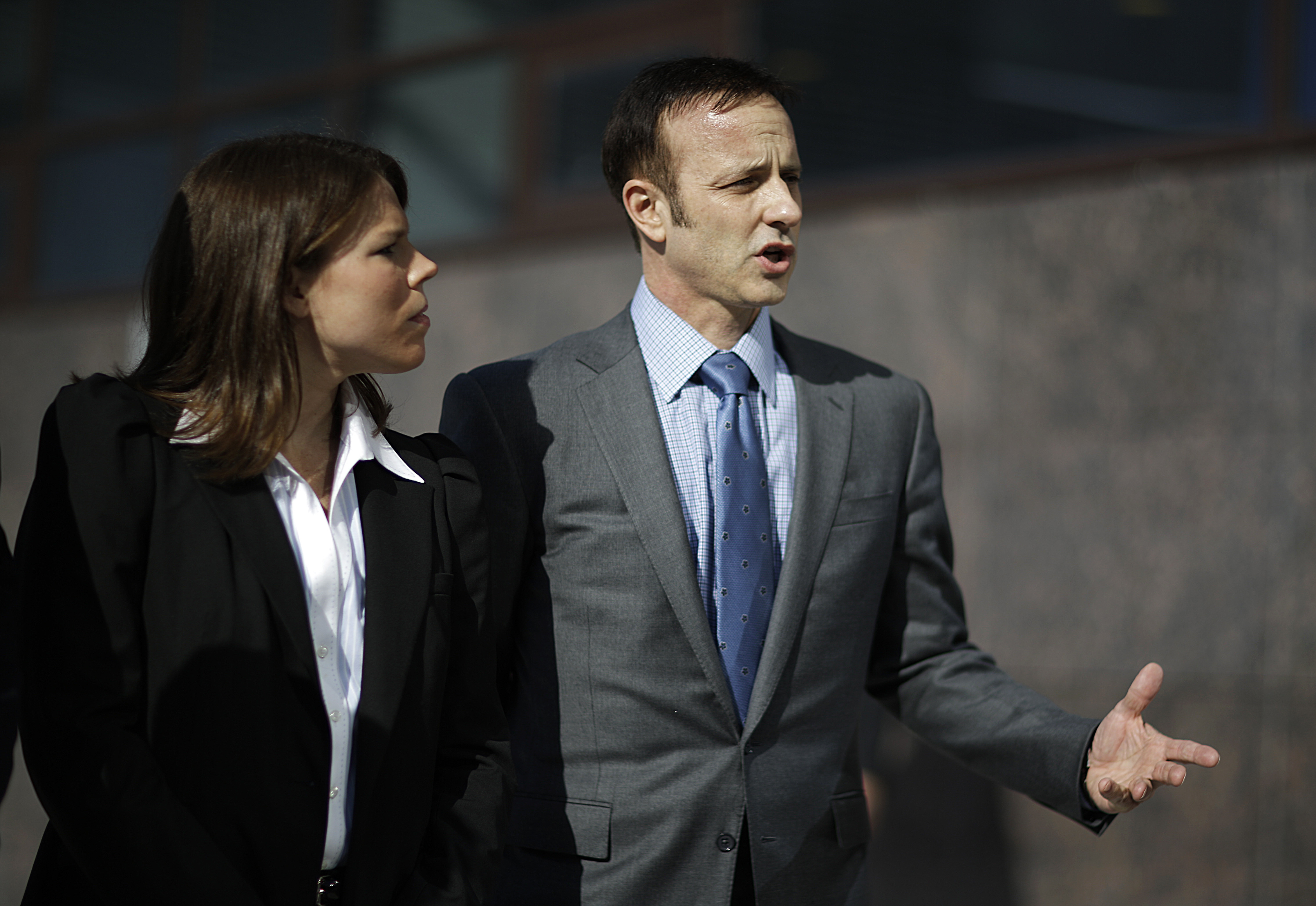 Olympic gold medal figure skater Brian Boitano, right, speaks during a news conference with fellow member of the U.S. delegation, former United States hockey player Caitlin Cahow, ahead of the opening ceremony at the 2014 Winter Olympics, Friday, Feb. 7, 2014, in Sochi, Russia. (AP Photo/David Goldman)