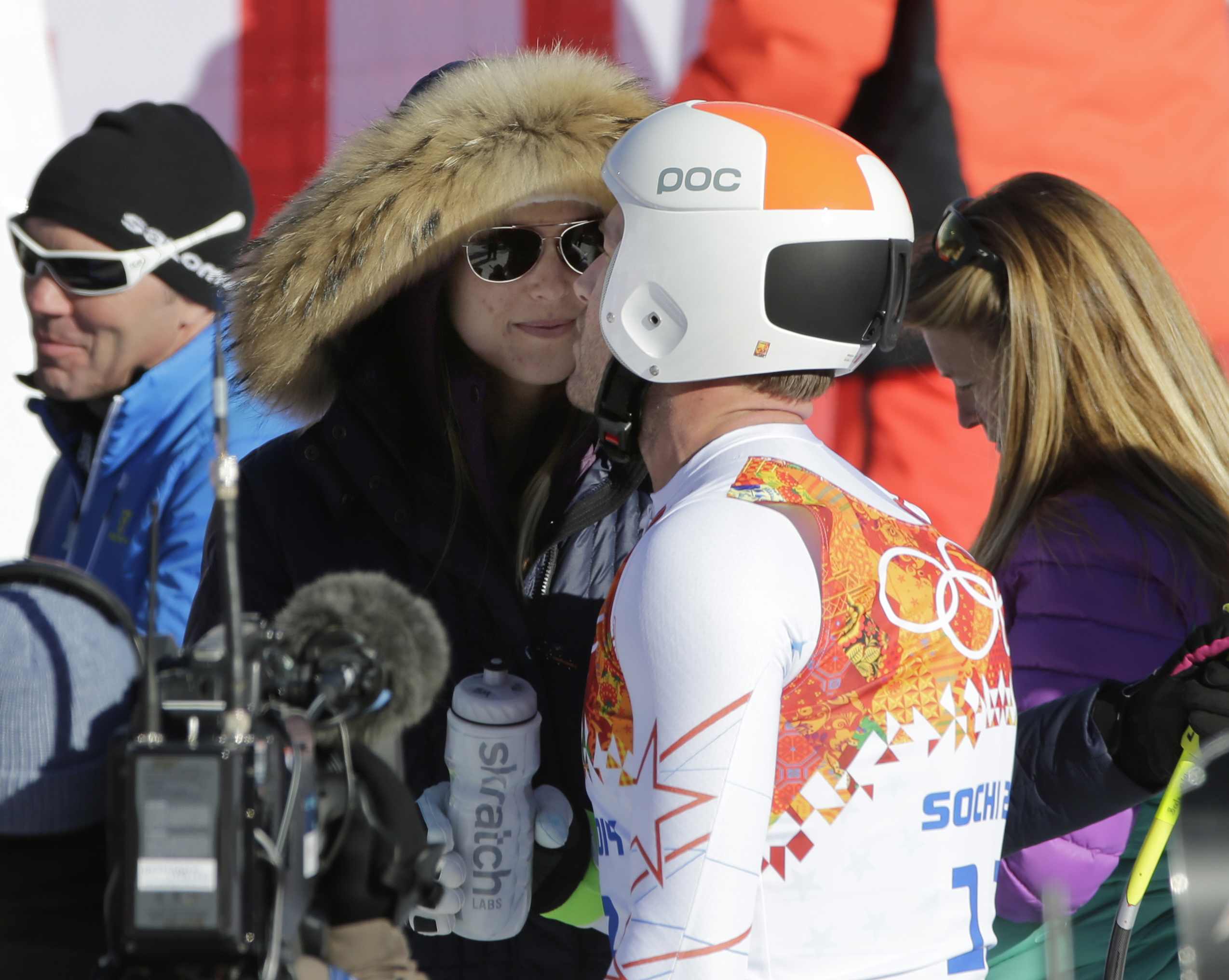 United States' Bode Miller leans in to kiss his wife, morgan, after a men's downhill training run for the Sochi 2014 Winter Olympics, Saturday, Feb. 8, 2014, in Krasnaya Polyana, Russia. (AP Photo/Gero Breloer)