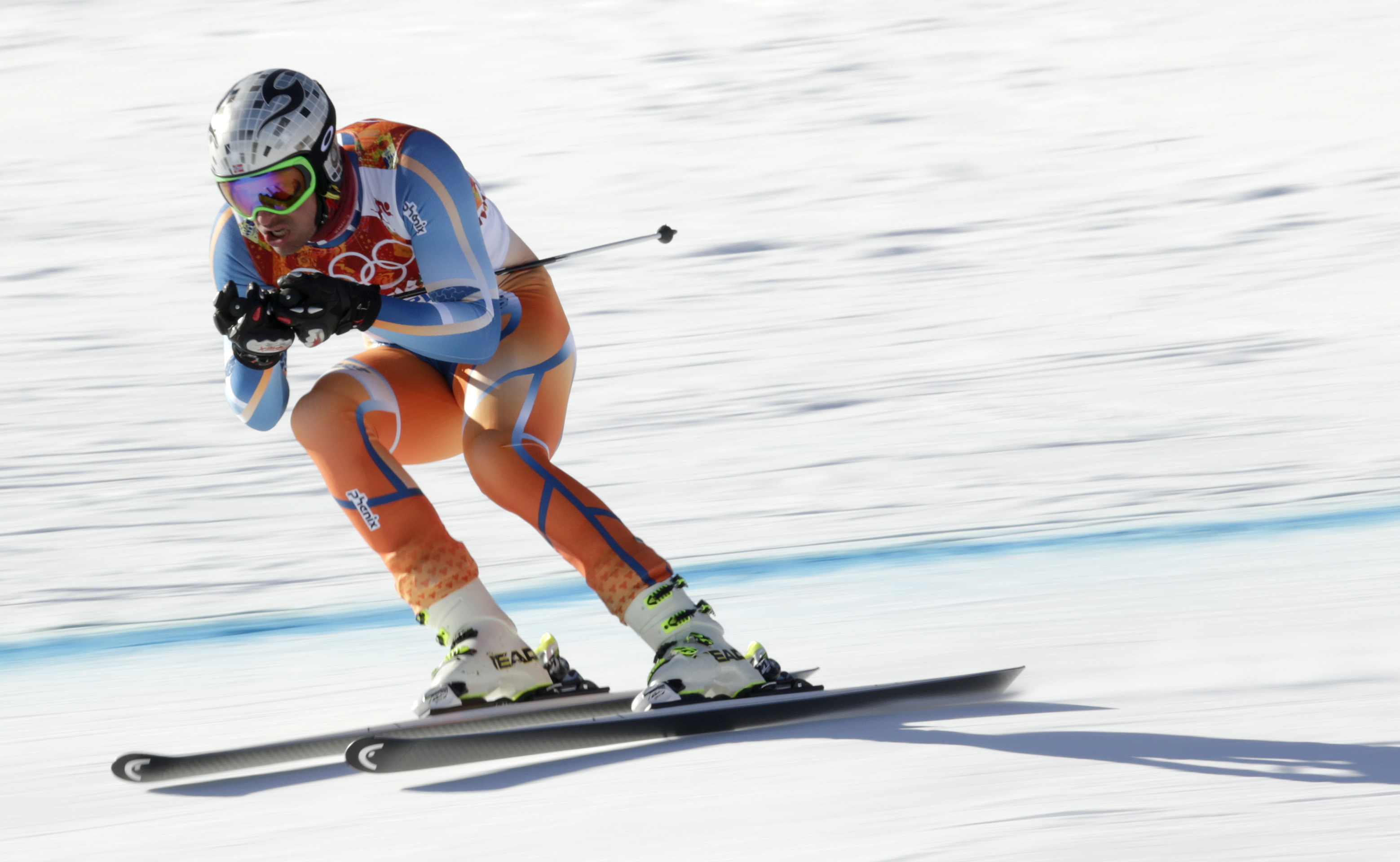 Norway's Aksel Lund Svindal speeds down the course during a men's downhill training run for the Sochi 2014 Winter Olympics, Saturday, Feb. 8, 2014, in Krasnaya Polyana, Russia.(AP Photo/Charles Krupa)