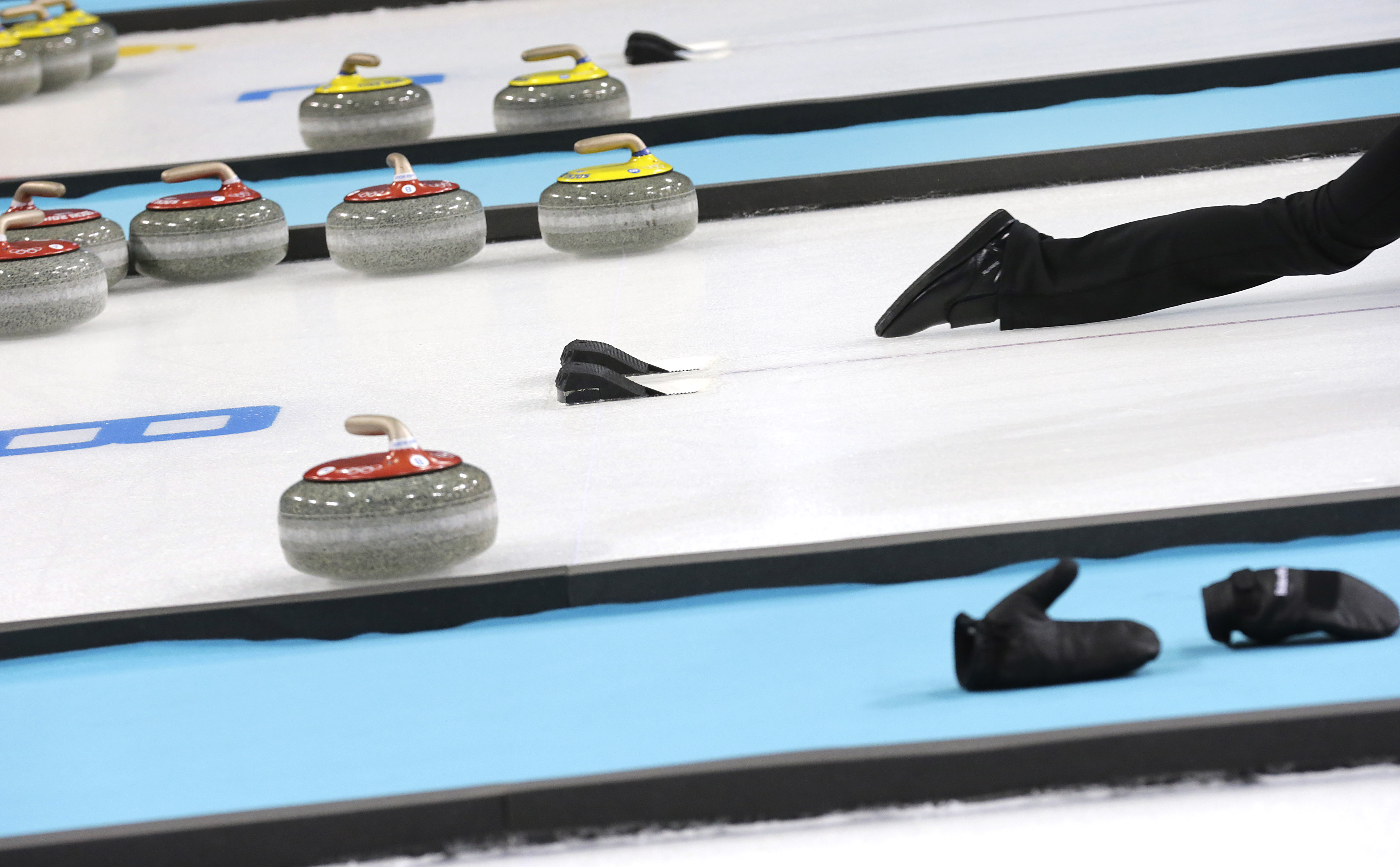Denmark's Helle Simonsen slides off the hack as she delivers the rock during the first day of training at the 2014 Winter Olympics, Saturday, Feb. 8, 2014, in Sochi, Russia. (AP Photo/Wong Maye-E)