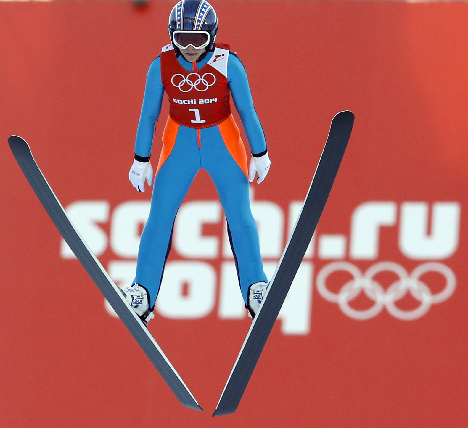 Sarah Hendrickson of the United States soars through the air during a women's ski jumping training session at the 2014 Winter Olympics, Saturday, Feb. 8, 2014, in Krasnaya Polyana, Russia. (AP Photo/Matthias Schrader)