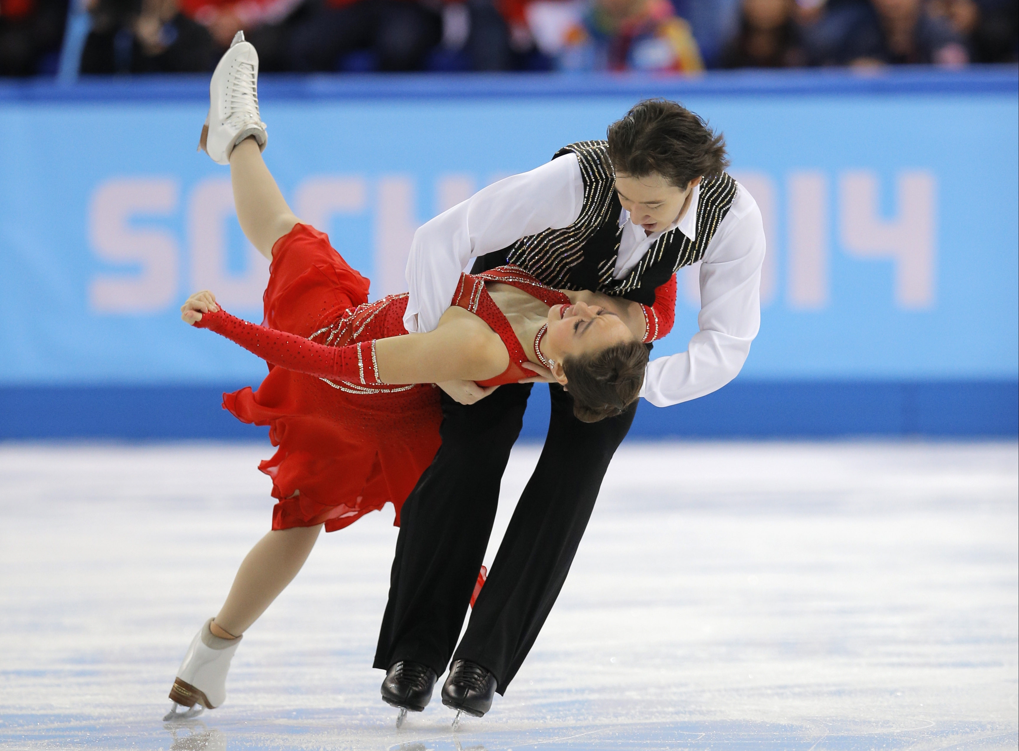 Cathy Reed and Chris Reed of Japan compete in the team ice dance short dance figure skating competition at the Iceberg Skating Palace during the 2014 Winter Olympics, Saturday, Feb. 8, 2014, in Sochi, Russia. (AP Photo/Vadim Ghirda)