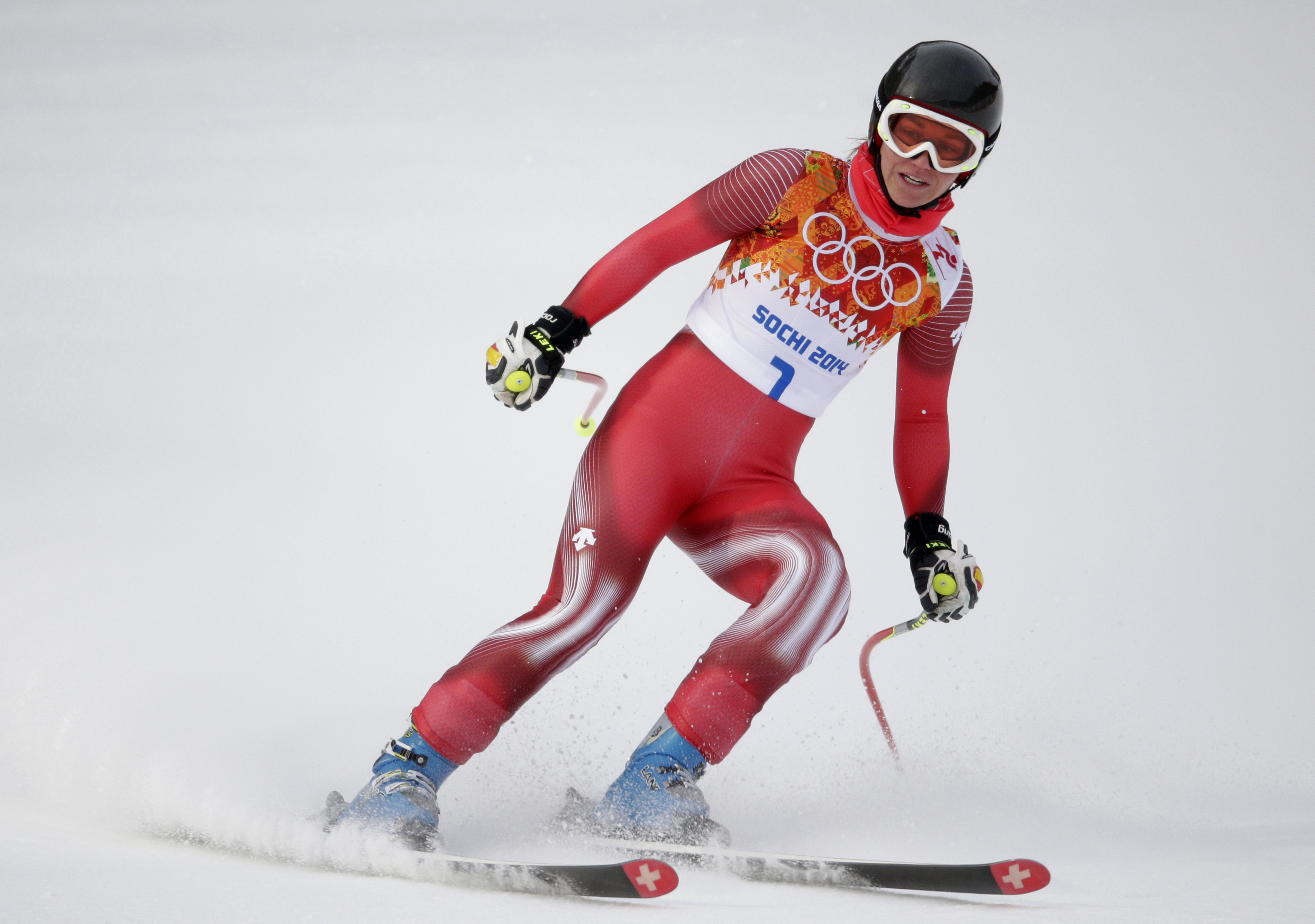 Switzerland's Fabienne Suter comes to a halt at the end of a women's downhill training run for the Sochi 2014 Winter Olympics, Sunday, Feb. 9, 2014, in Krasnaya Polyana, Russia. (AP Photo/Jae C. Hong)
