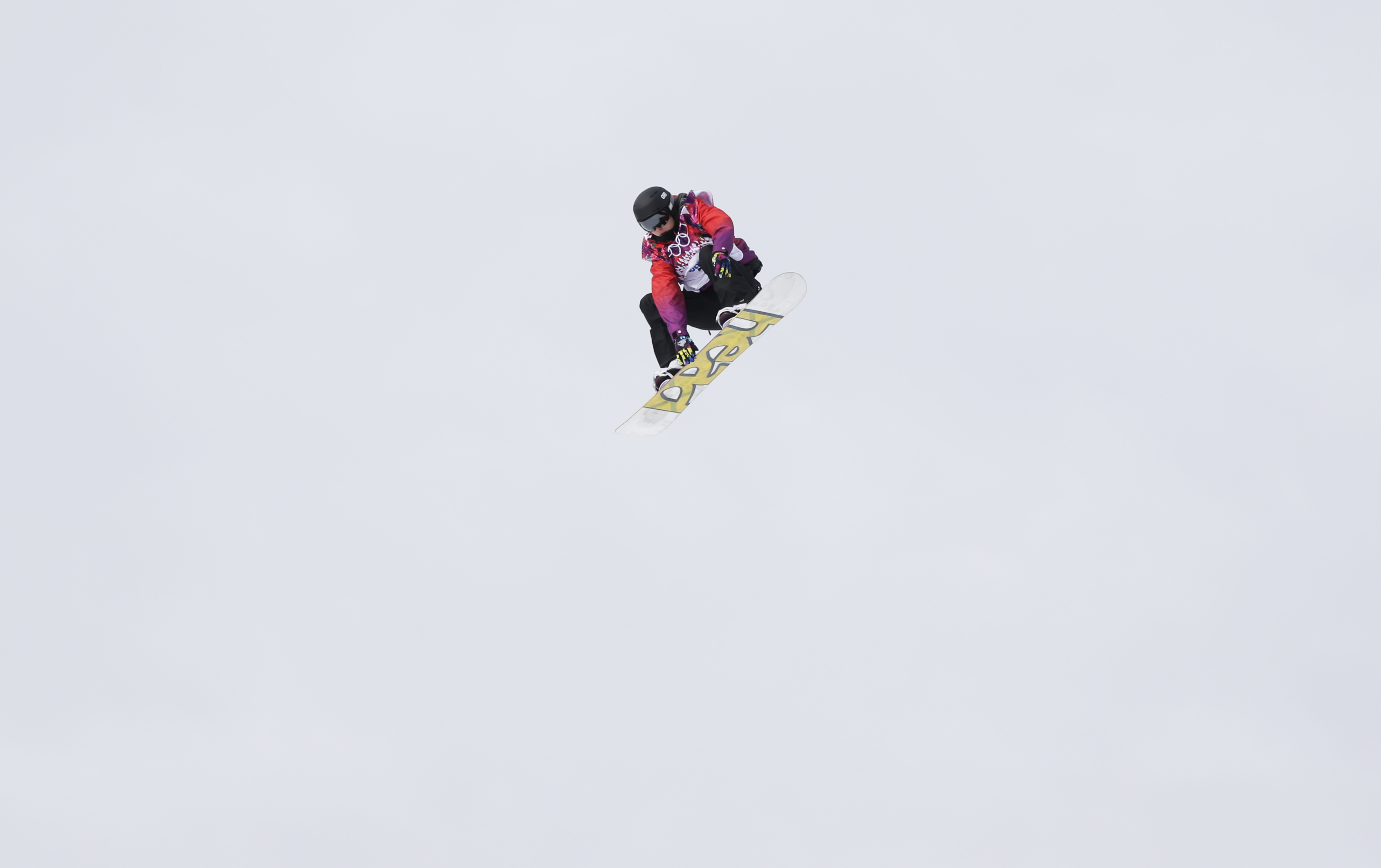 Britain's Aimee Fuller takes a jump during the women's snowboard slopestyle semifinal on Sunday.