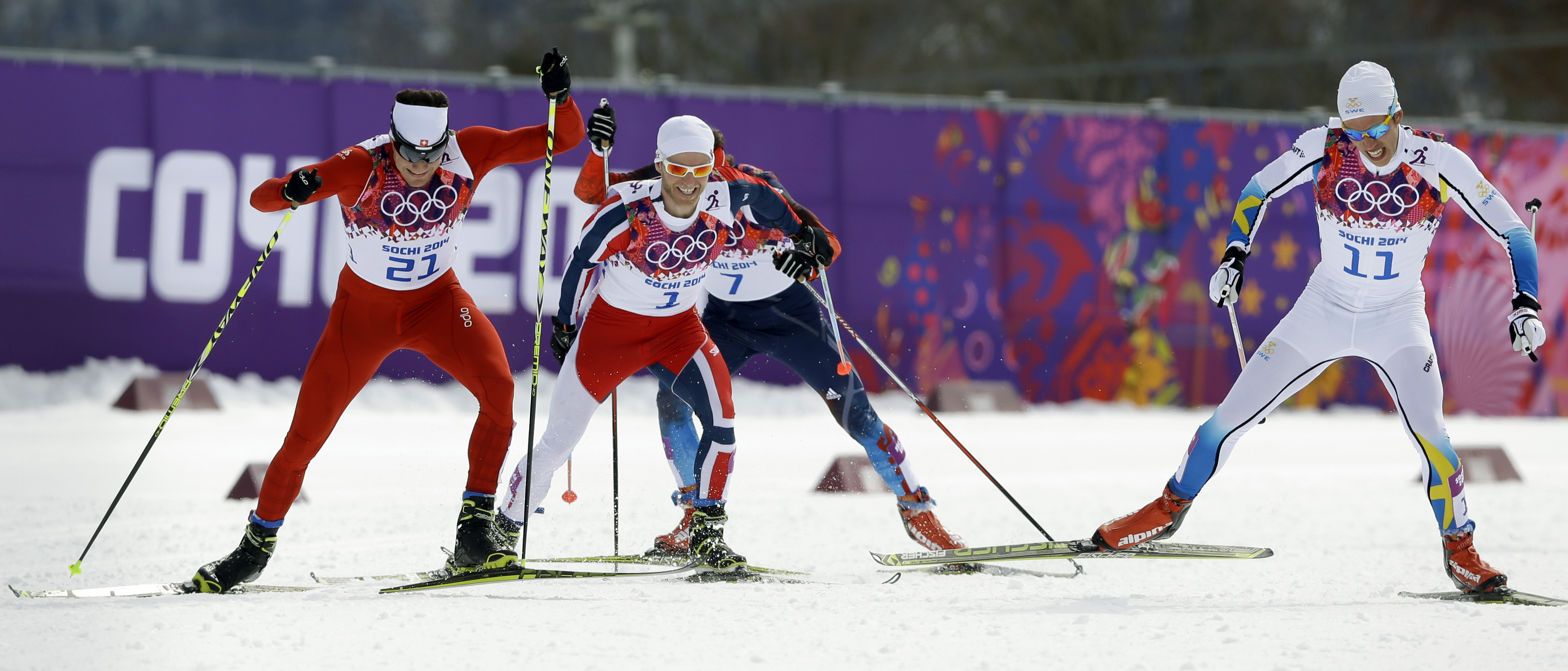 Switzerland's Dario Cologna, left, competes alongside Norway's Martin Johnsrud Sundby, Russia's Maxim Vylegzhanin and Sweden's Marcus Hellner, right, during the men's cross-country 30k skiathlon, at the 2014 Winter Olympics, Sunday, Feb. 9, 2014, in Krasnaya Polyana, Russia. Cologna got the gold, Hellner clinched the silver and  Sundby won the bronze medal. (AP Photo/Kirsty Wigglesworth)