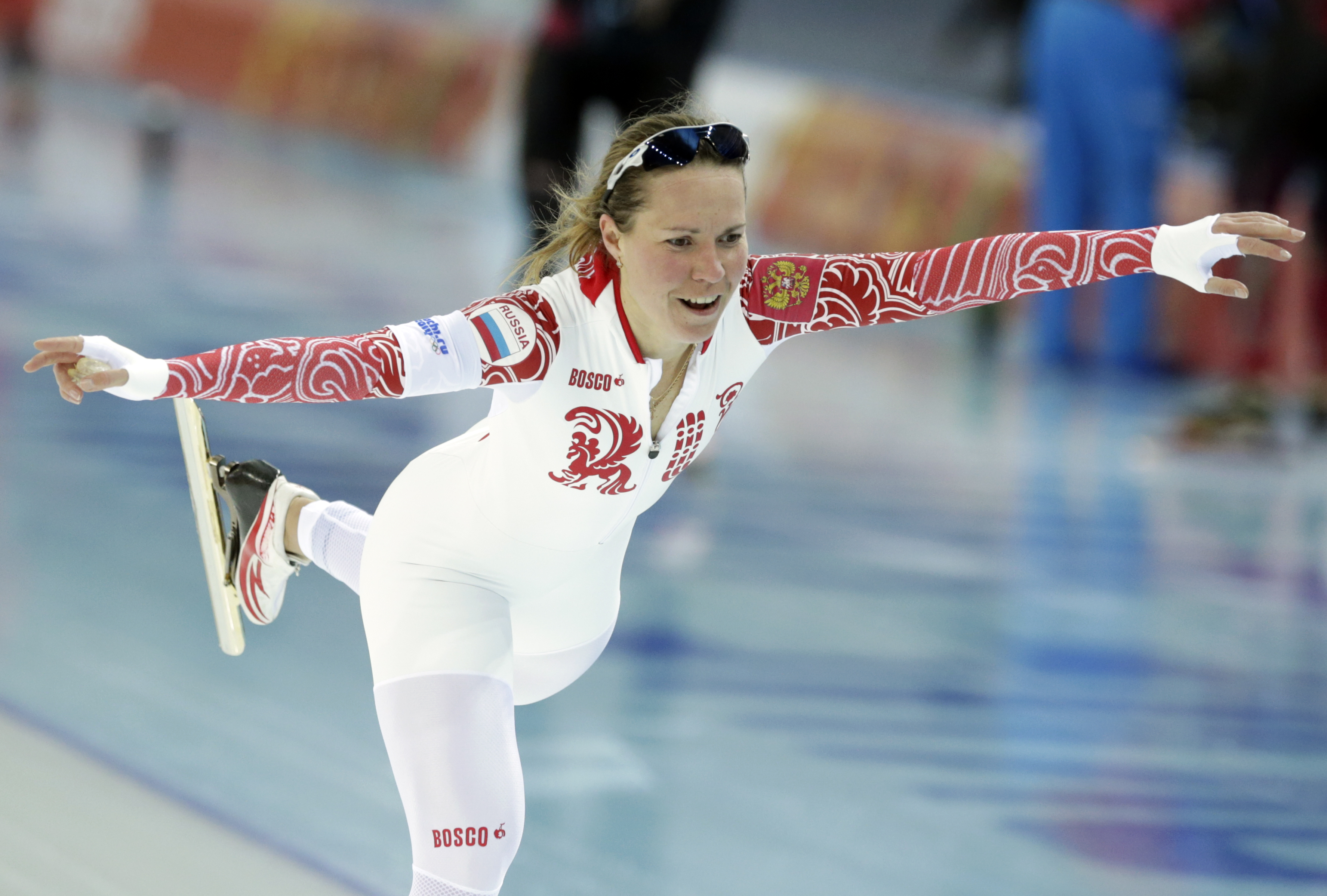 Russia's Olga Graf celebrates her time after competing in the women's 3,000-meter speedskating race at the Adler Arena Skating Center during the 2014 Winter Olympics, Sunday, Feb. 9, 2014, in Sochi, Russia. (AP Photo/Matt Dunham)