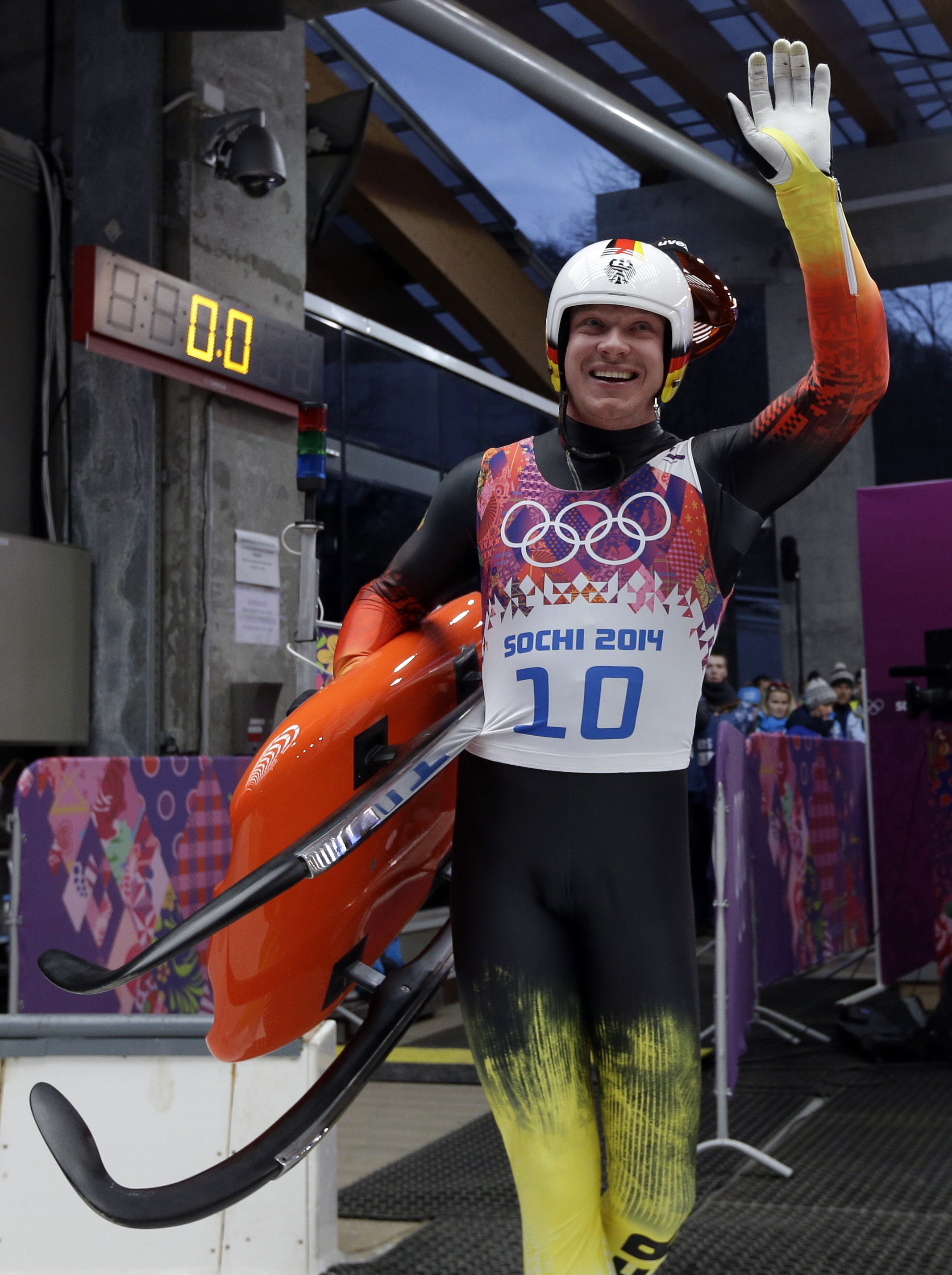 Felix Loch of Germany waves in the finish area during the men's singles luge final at the 2014 Winter Olympics, Sunday, Feb. 9, 2014, in Krasnaya Polyana, Russia.(AP Photo/Natacha Pisarenko)