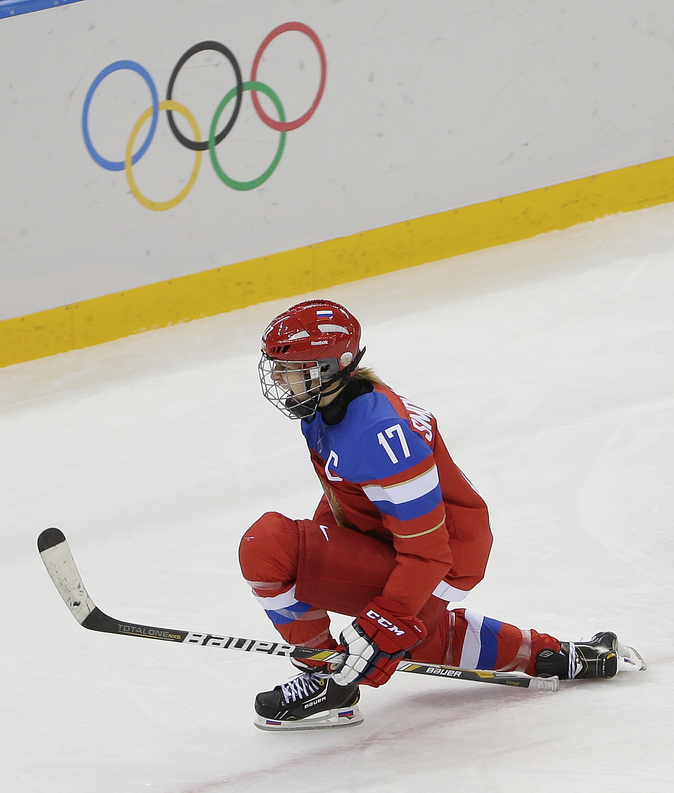 Yekaterina Smolentseva of Russia celebrates her goal against Germany during the third period of the 2014 Winter Olympics women's ice hockey game at Shayba Arena, Sunday, Feb. 9, 2014, in Sochi, Russia. (AP Photo/Matt Slocum)