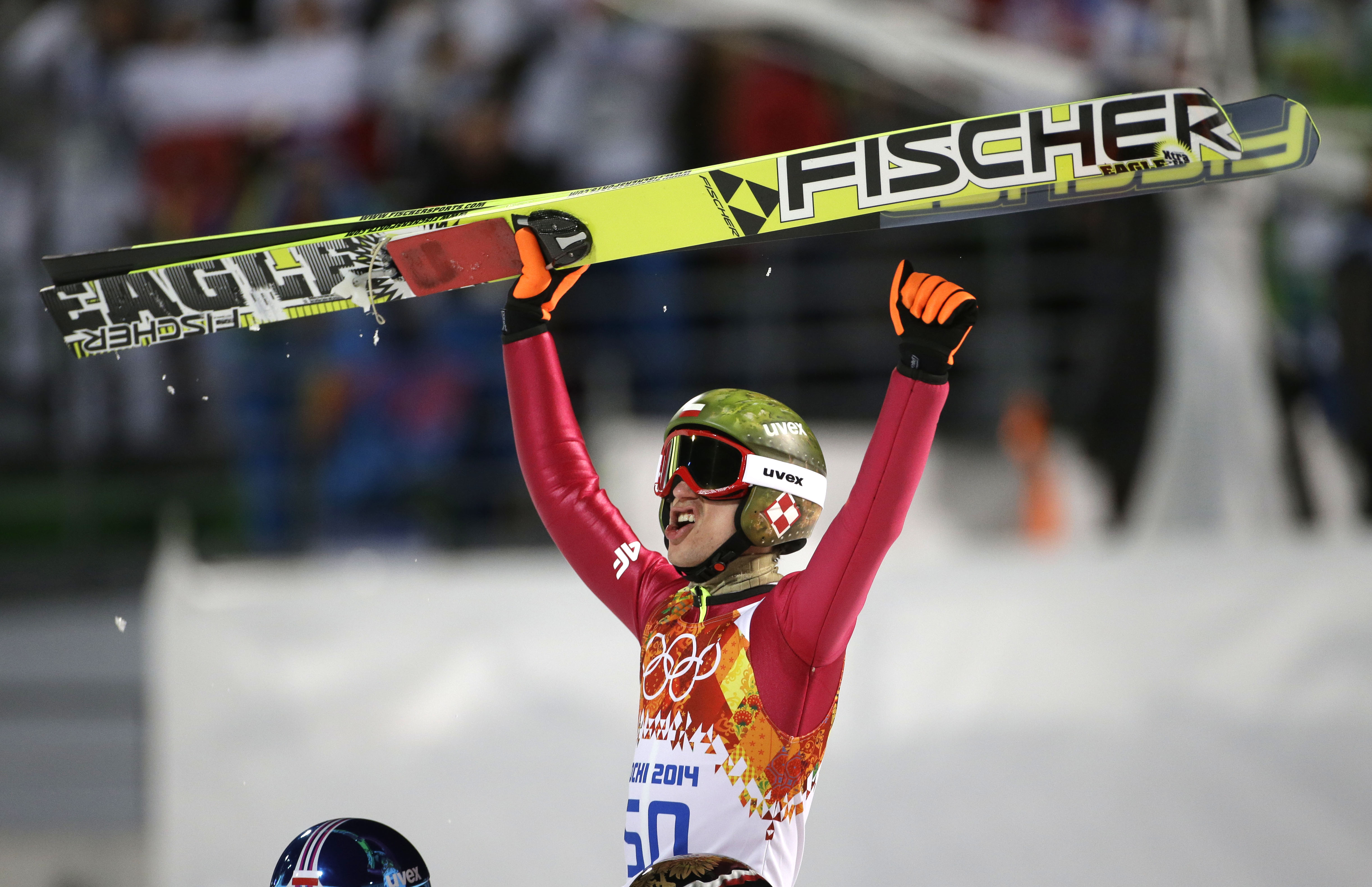 Poland's Kamil Stoch celebrates winning the gold medal during the men's normal hill ski jumping final at the 2014 Winter Olympics, Sunday, Feb. 9, 2014, in Krasnaya Polyana, Russia. (AP Photo/Gregorio Borgia)