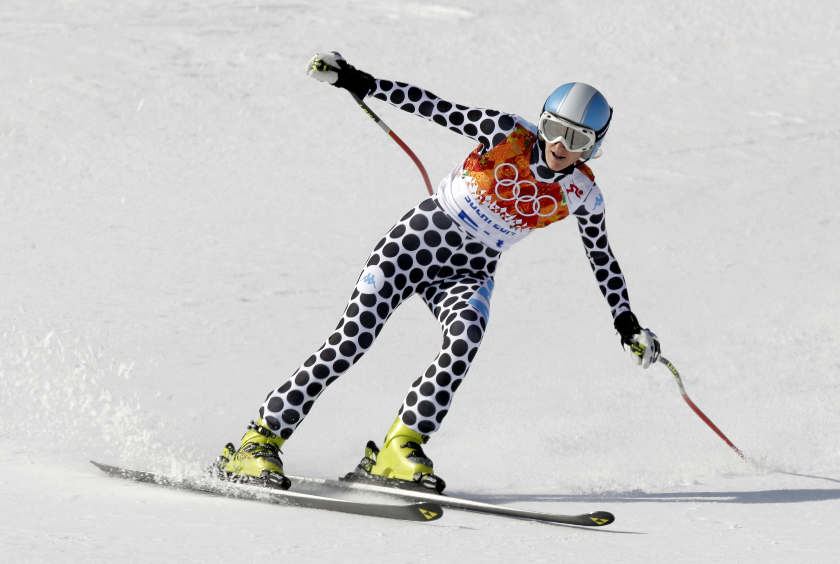 Argentina's Macarena Simari Birkner comes to a halt at the end of the downhill portion of the women's supercombined at the Sochi 2014 Winter Olympics, Monday, Feb. 10, 2014, in Krasnaya Polyana, Russia. (AP Photo/Gero Breloer)