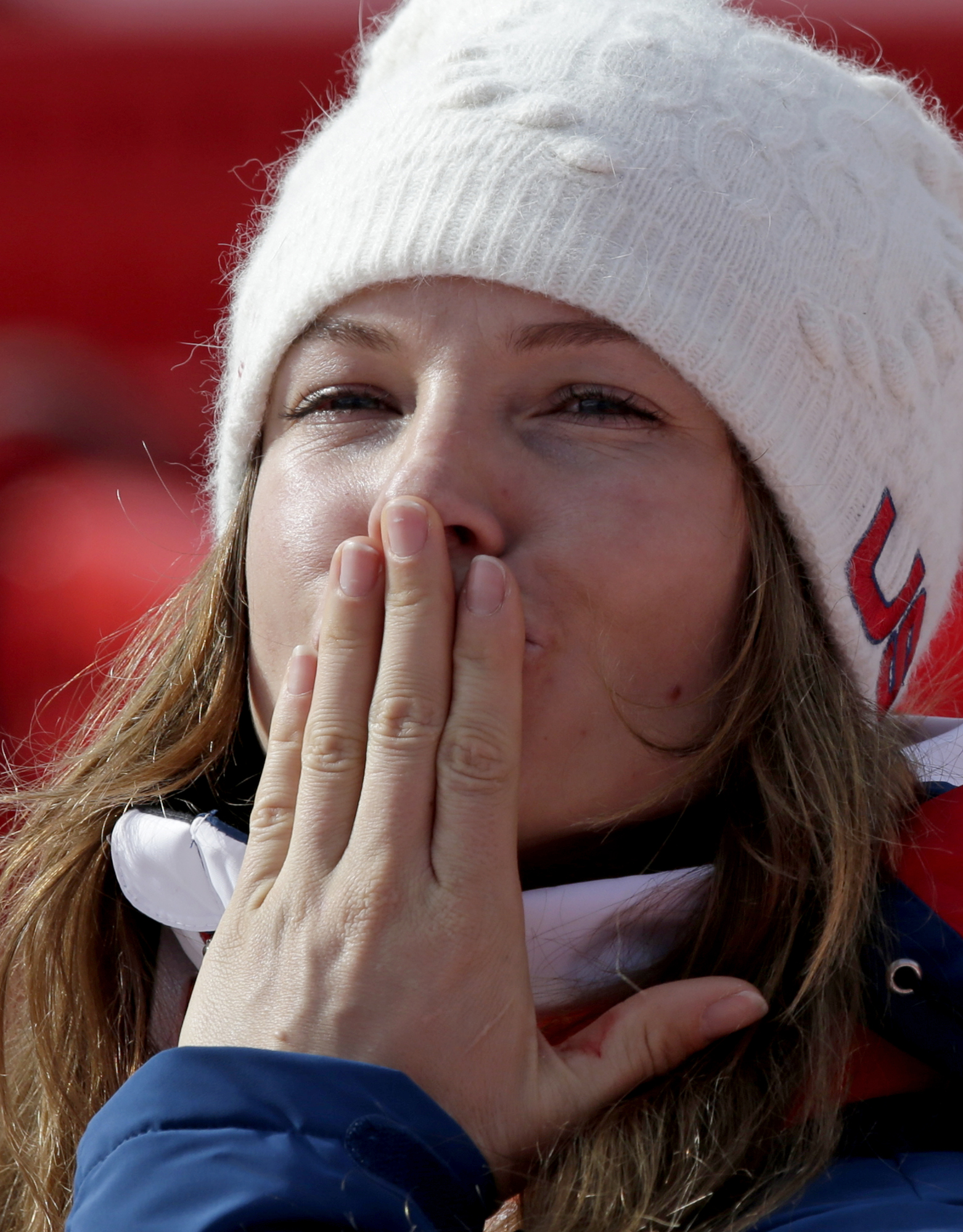 United States' Julia Mancuso blows a kiss as she leaves the finish area after the downhill portion of the women's supercombined at the Sochi 2014 Winter Olympics, Monday, Feb. 10, 2014, in Krasnaya Polyana, Russia. (AP Photo/Gero Breloer)