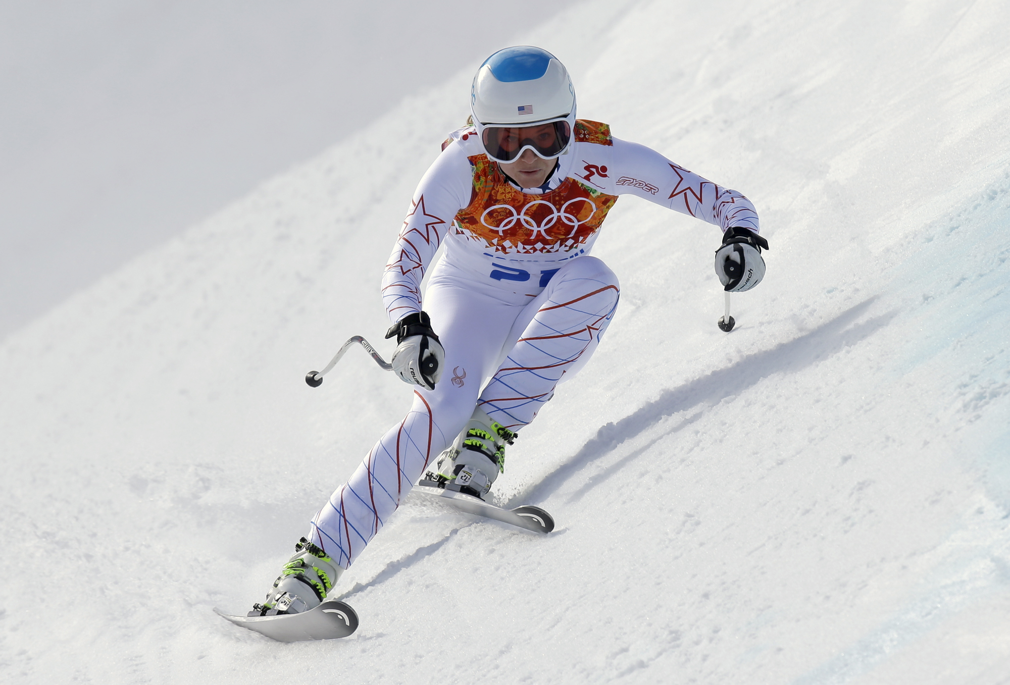 United States' Julia Mancuso makes a turn in the downhill portion of the women's supercombined at the Sochi 2014 Winter Olympics, Monday, Feb. 10, 2014, in Krasnaya Polyana, Russia. (AP Photo/Luca Bruno)
