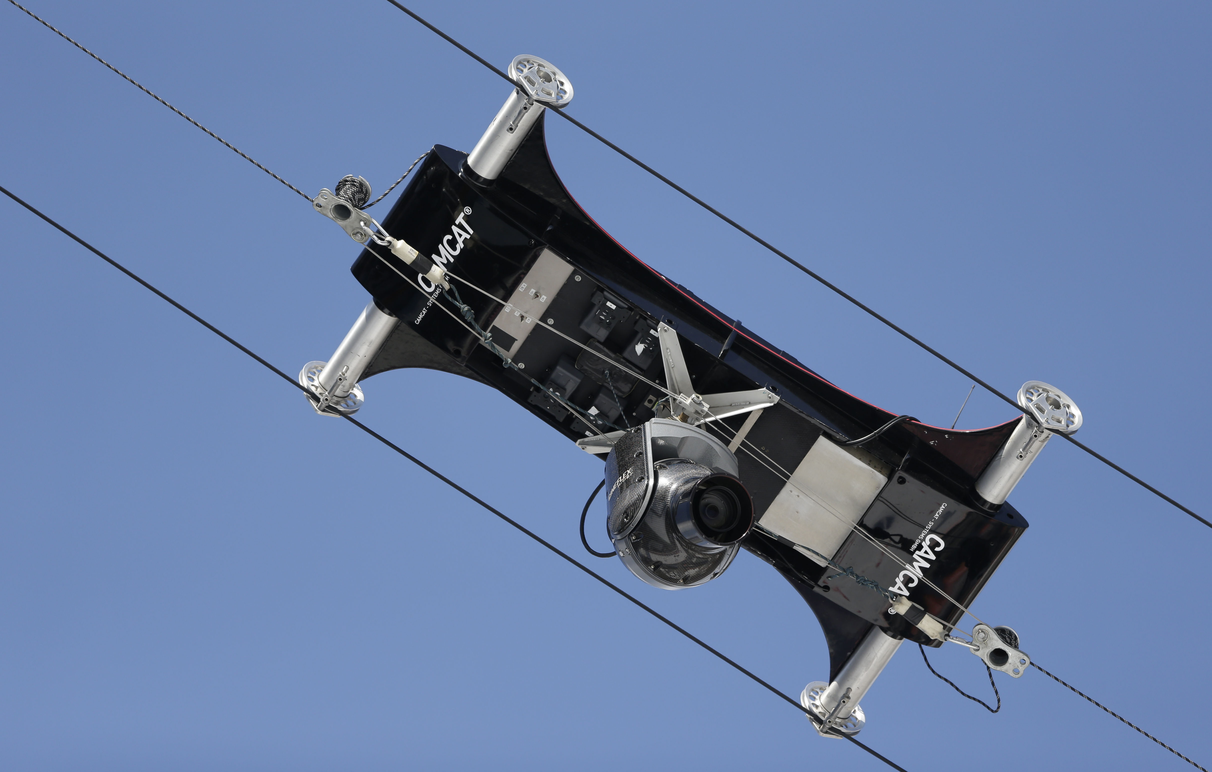 A spider camera records the Nordic combined training on Monday.