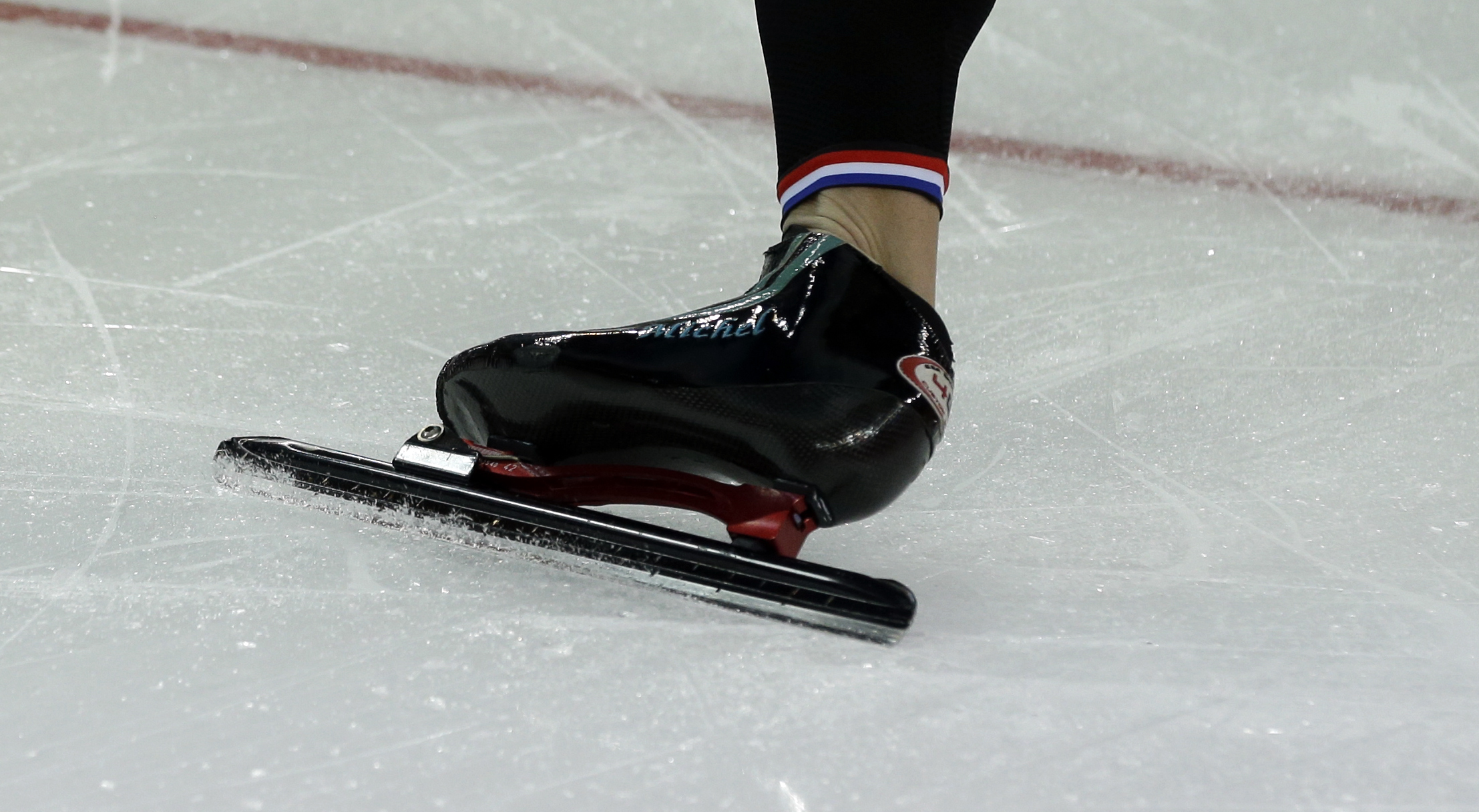 The skate of Michel Mulder of the Netherlands bears his name as he practices his start prior to the start of the men's 500-meter speedskating race at the Adler Arena Skating Center during the 2014 Winter Olympics, Monday, Feb. 10, 2014, in Sochi, Russia. (AP Photo/Patrick Semansky)