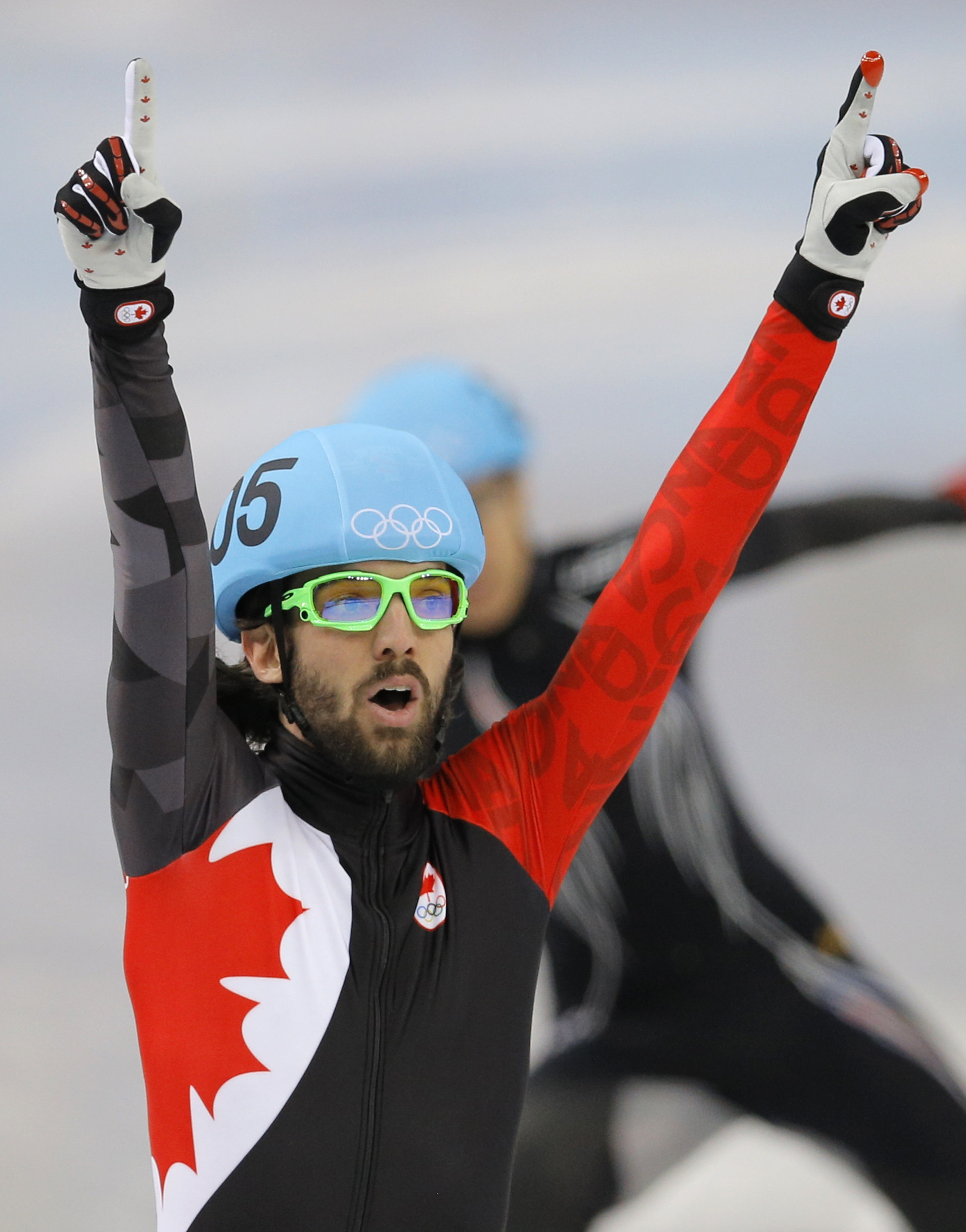 Charles Hamelin of Canada celebrates winning the men's 1500m short track speedskating final at the Iceberg Skating Palace during the 2014 Winter Olympics, Monday, Feb. 10, 2014, in Sochi, Russia. (AP Photo/Vadim Ghirda)
