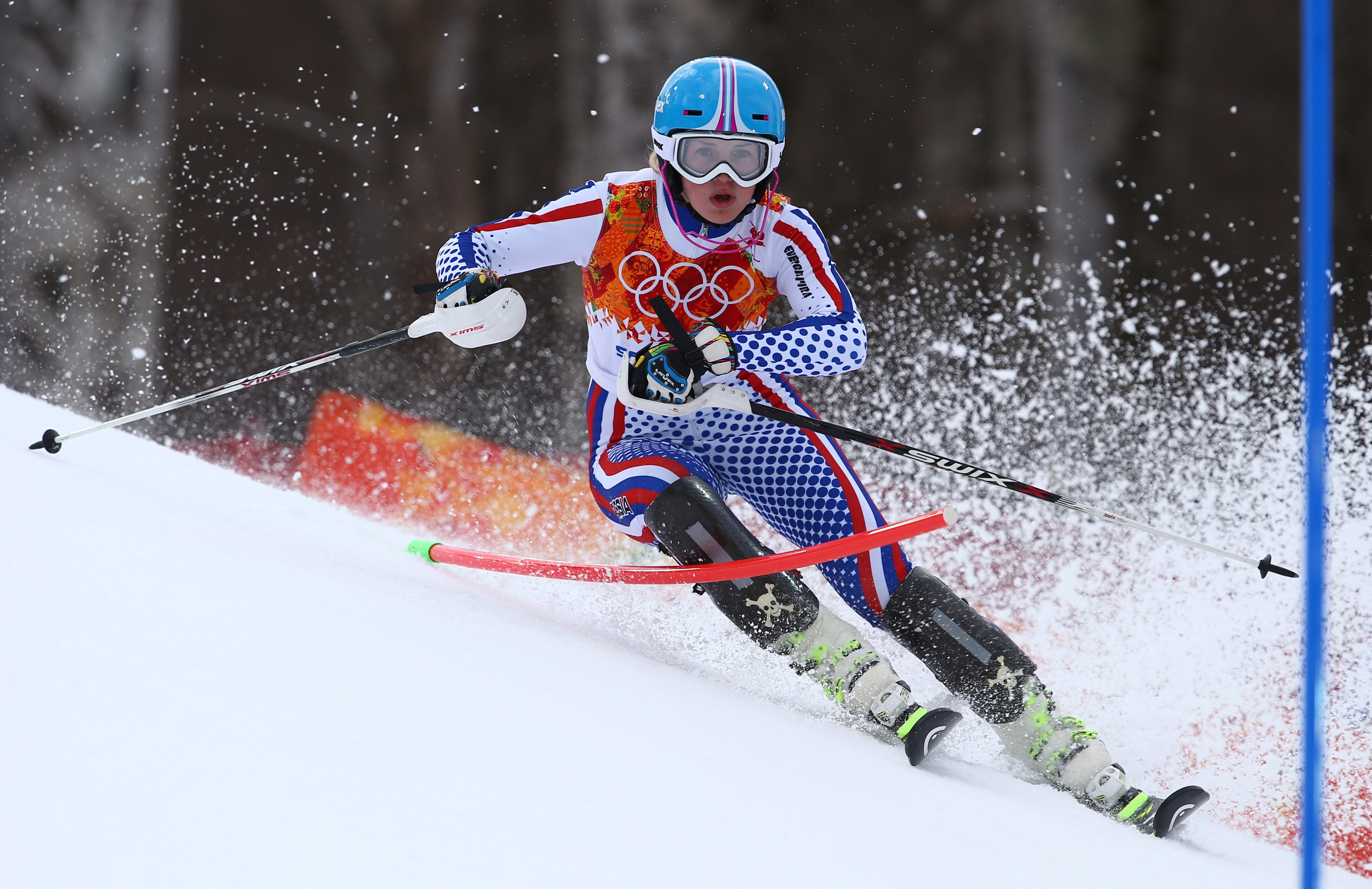 Russia's Yelena Yakovishina passes a gate in the slalom portion of the women's supercombined in the Sochi 2014 Winter Olympics, Monday, Feb. 10, 2014, in Krasnaya Polyana, Russia.(AP Photo/Alessandro Trovati)