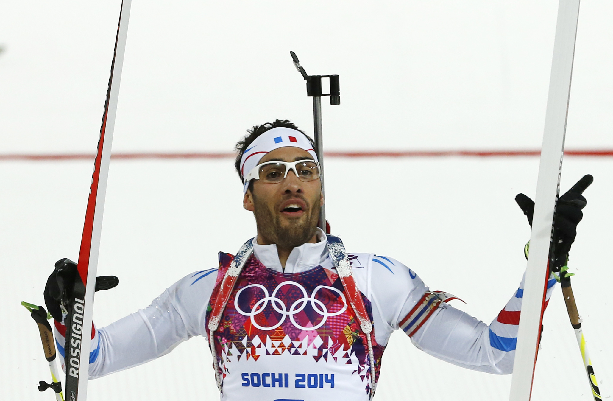 France's Martin Fourcade celebrates winning the gold during the men's biathlon 12.5k pursuit, at the 2014 Winter Olympics, Monday, Feb. 10, 2014, in Krasnaya Polyana, Russia. (AP Photo/Felipe Dana)