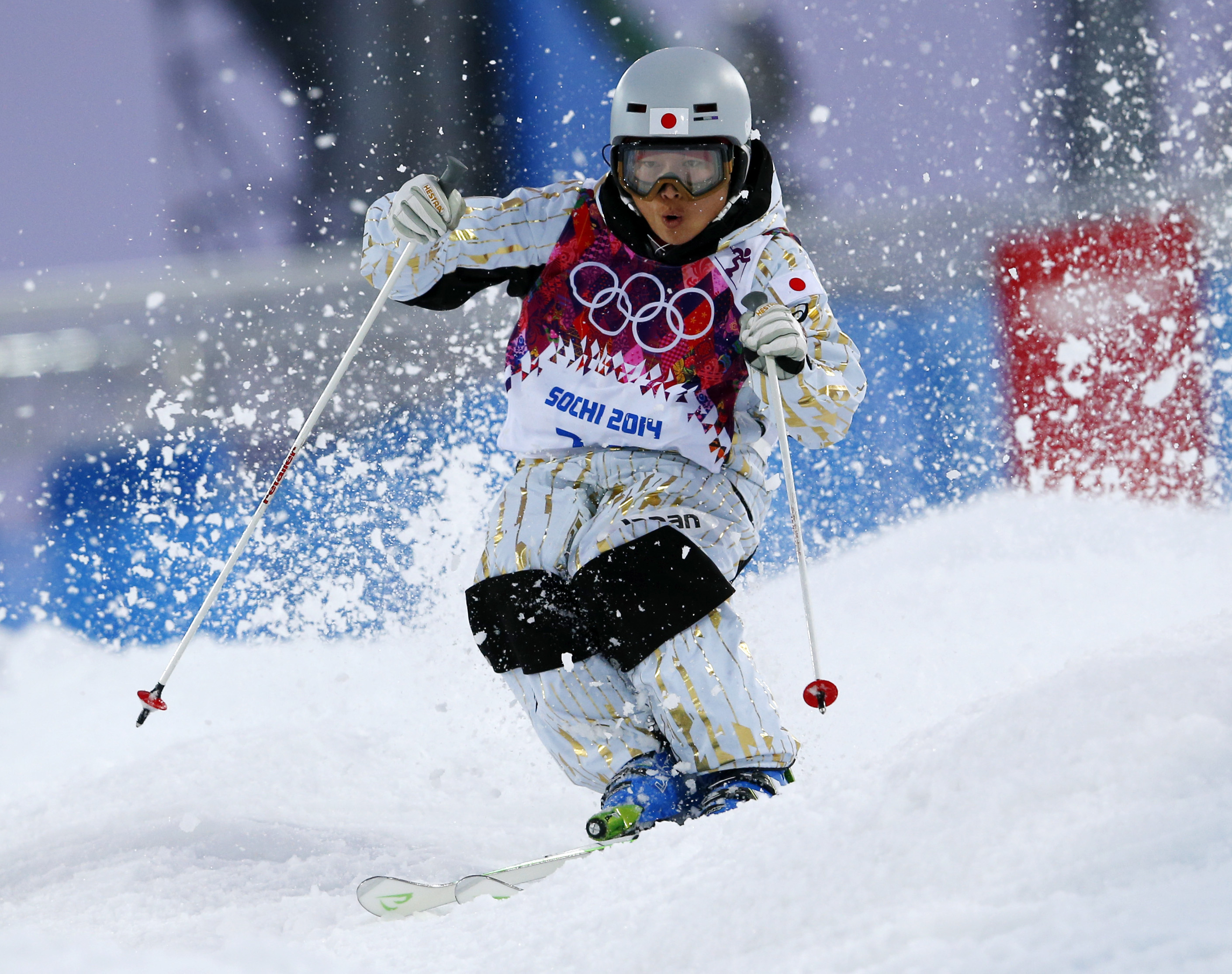 Japan's Nobuyuki Nishi runs the course during the men's moguls qualifying at the Rosa Khutor Extreme Park at the 2014 Winter Olympics, Monday, Feb. 10, 2014, in Krasnaya Polyana, Russia.  (AP Photo/Sergei Grits)
