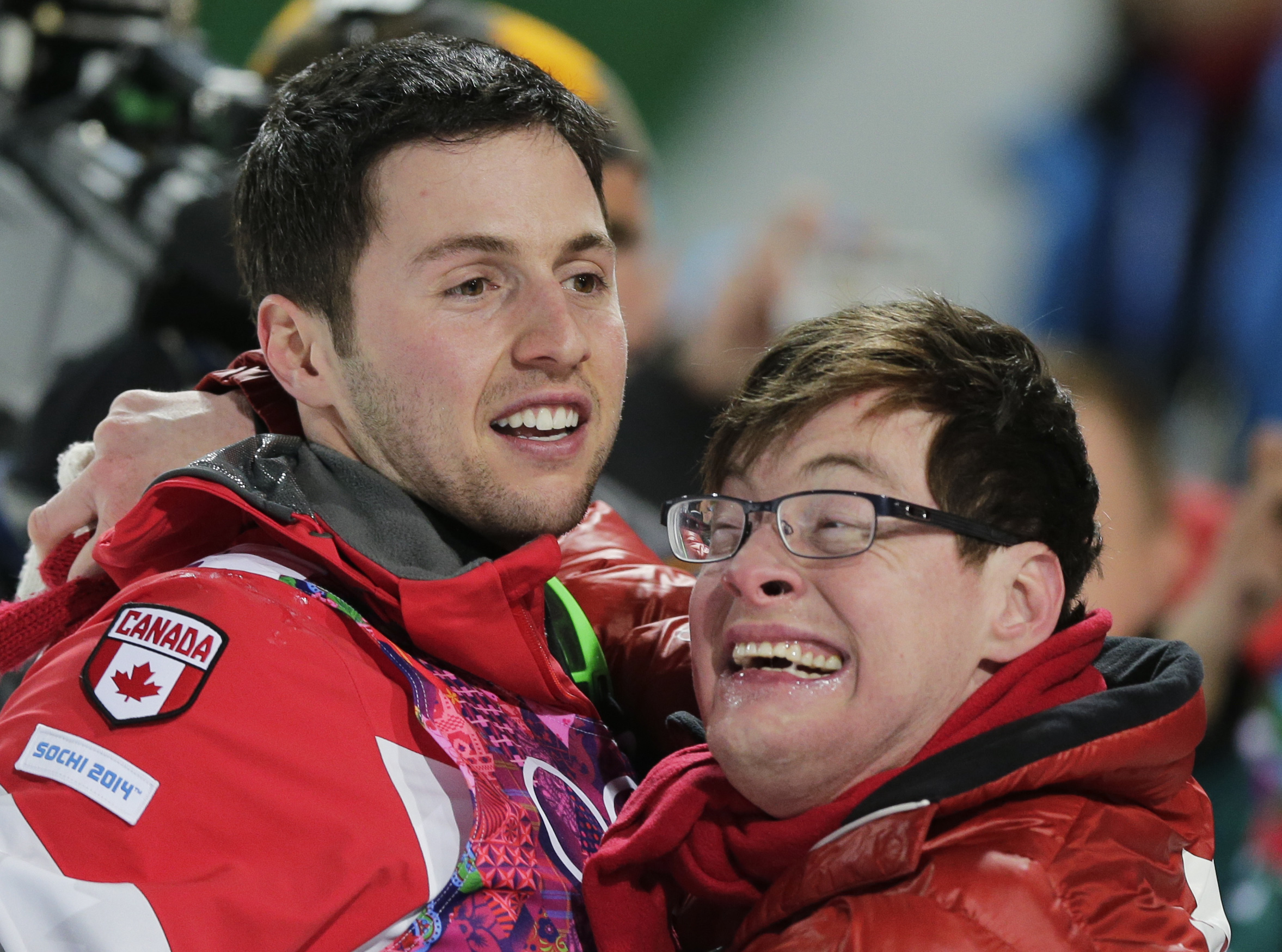 Canada's Alex Bilodeau, left, celebrates with his brother Frederic after winning the gold medal in the men's moguls final on Monday.
