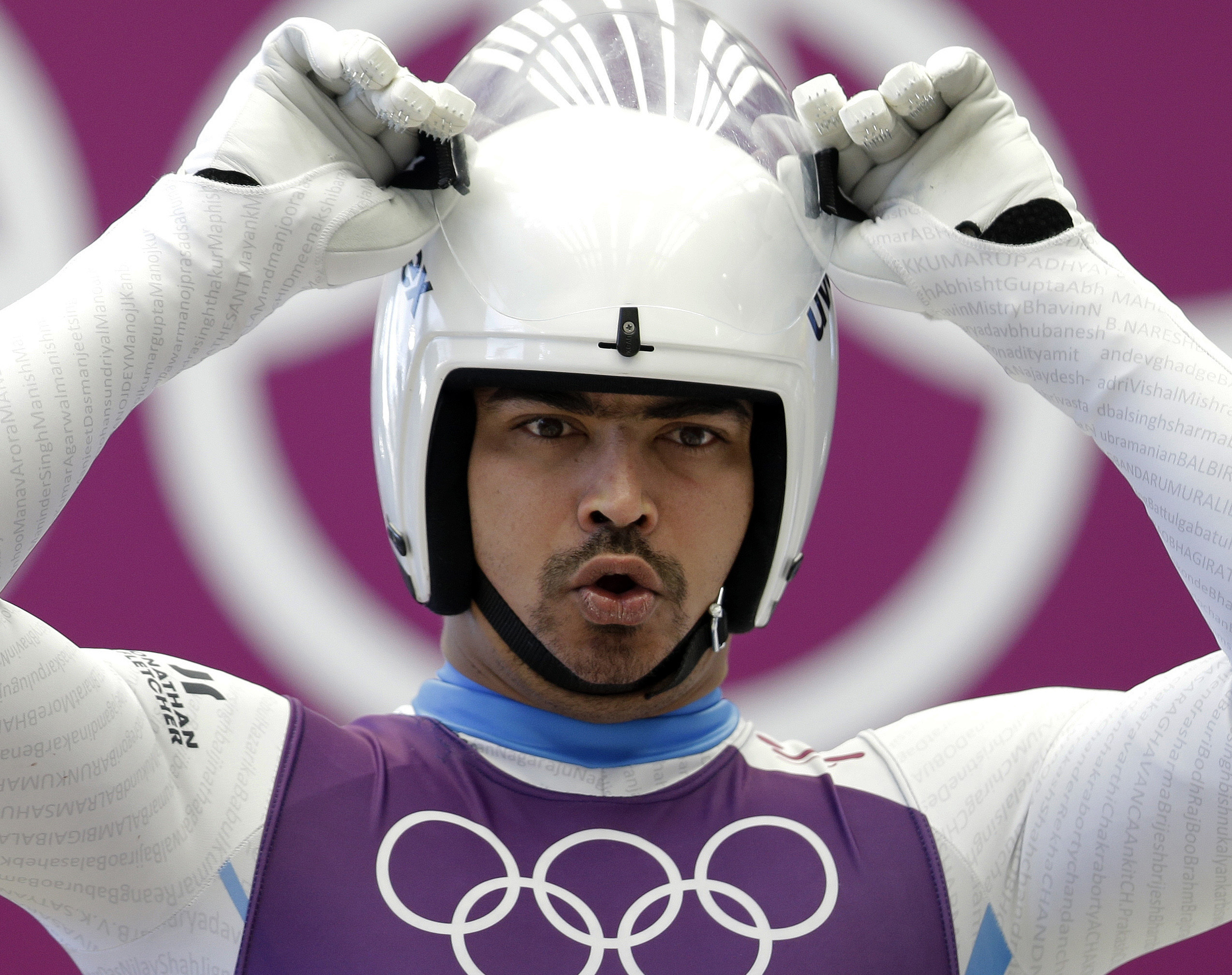 FILE - In this Feb. 6, 2014 file photo, Shiva Keshavan of India prepares to start his run during a training session for the men's singles luge at the 2014 Winter Olympics in Krasnaya Polyana, Russia. Keshavan competed under the Olympic flag because India's Olympic body had been suspended by the IOC in 2012 over a corruption scandal. On Tuesday, Feb. 11, 2014, the IOC executive board reinstated the Indian Olympic body after it held a weekend ballot that complied with ethics rules barring corruption-tainted officials from running for election. (AP Photo/Natacha Pisarenko, File)