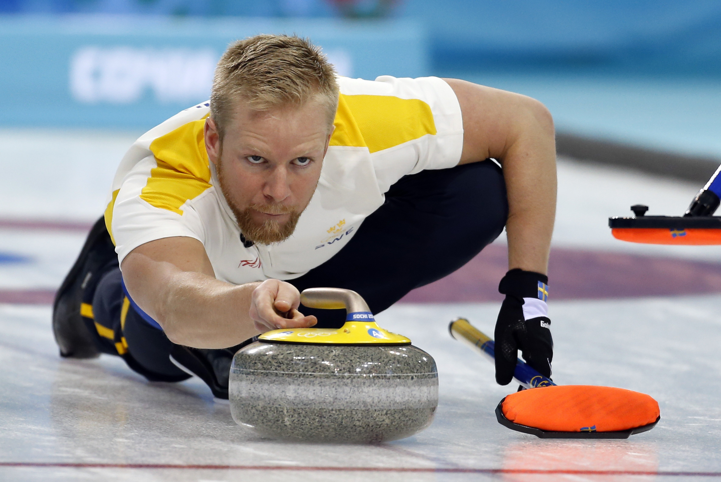 Sweden's skip Niklas Edin delivers the rock during men's curling competition against Canada at the 2014 Winter Olympics, Tuesday, Feb. 11, 2014, in Sochi, Russia. (AP Photo/Robert F. Bukaty)