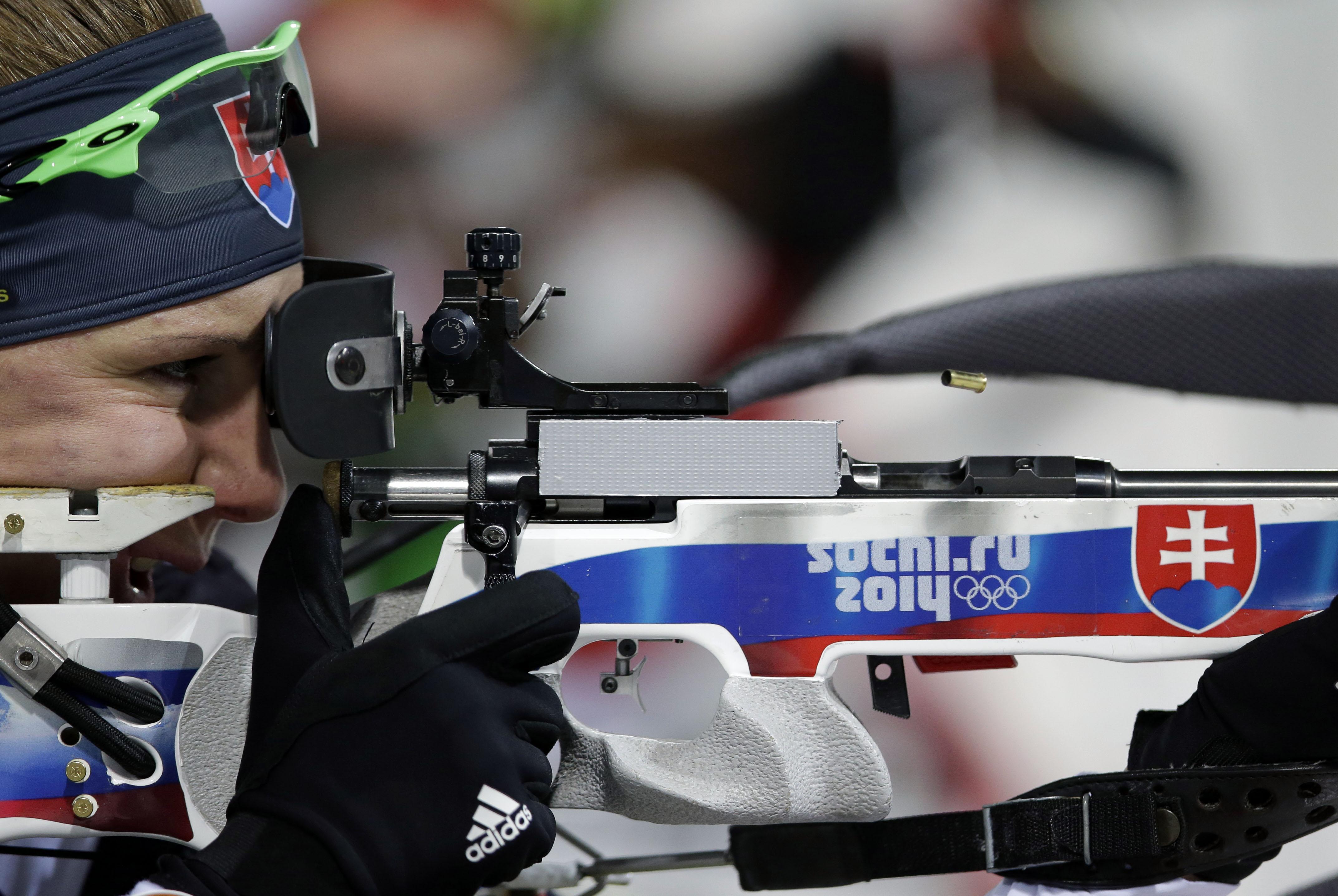 Slovakia's Anastasiya Kuzmina shoots during the women's biathlon 10k pursuit, at the 2014 Winter Olympics, Tuesday, Feb. 11, 2014, in Krasnaya Polyana, Russia. (AP Photo/Lee Jin-man)