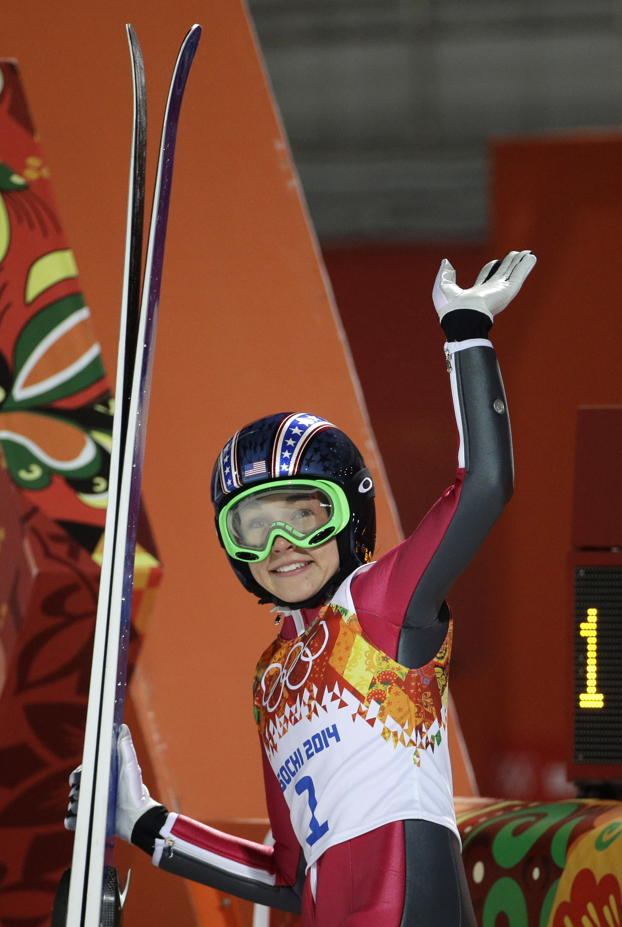 United States' Sarah Hendrickson smiles and waves after her first attempt during the women's normal hill ski jumping final at the 2014 Winter Olympics, Tuesday, Feb. 11, 2014, in Krasnaya Polyana, Russia. (AP Photo/Gregorio Borgia)