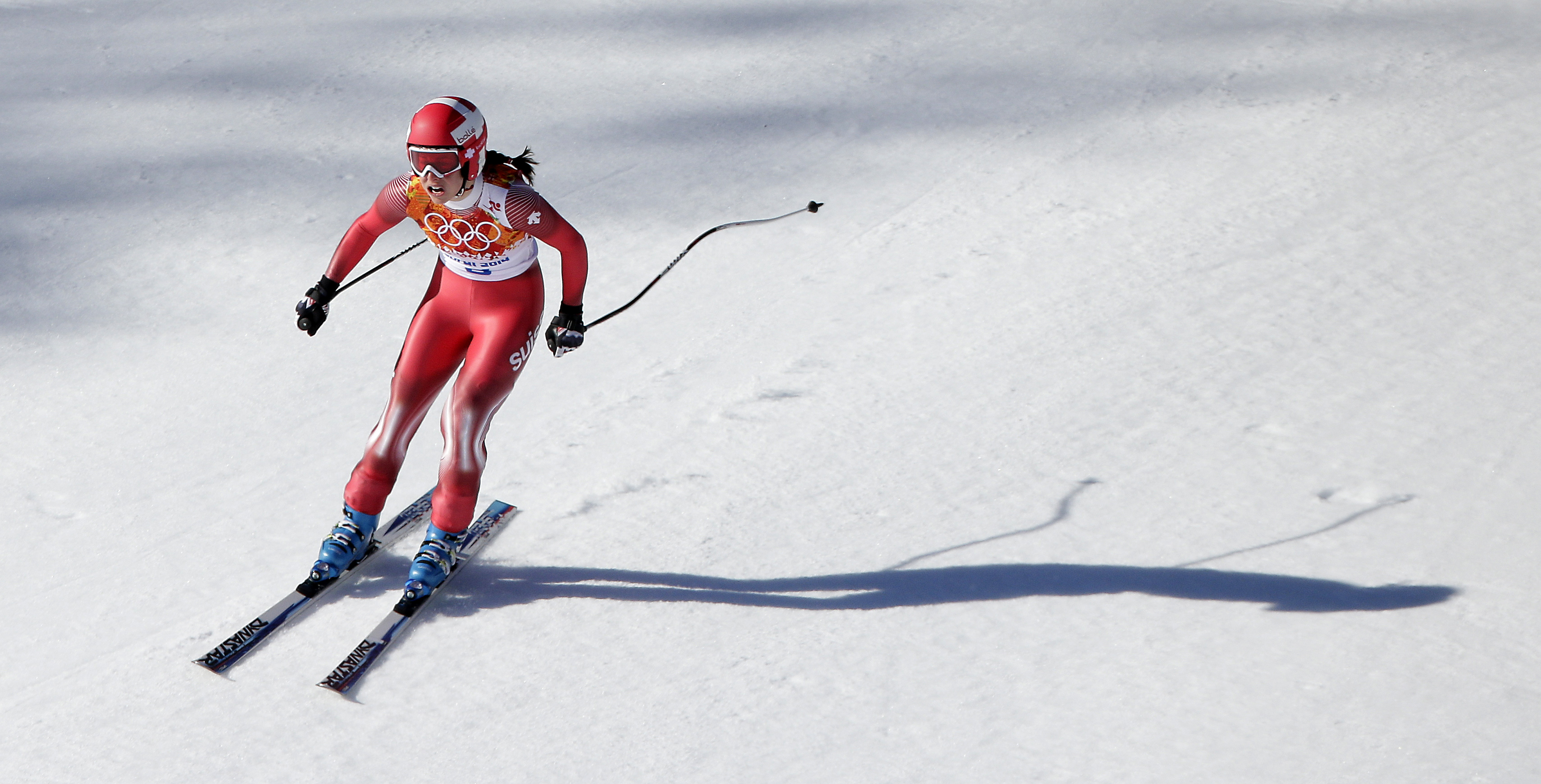 Gold medalist Switzerland's Dominique Gisin competes during the women's downhill at the 2014 Winter Olympics, Wednesday, Feb. 12, 2014, in Krasnaya Polyana, Russia. (AP Photo/Charlie Riedel)
