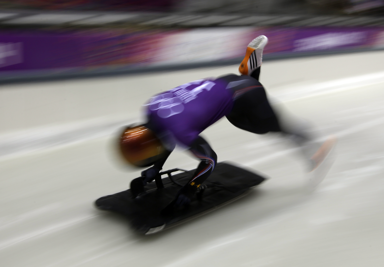 John Daly of the United States starts his run during the men's skeleton training at the 2014 Winter Olympics, Wednesday, Feb. 12, 2014, in Krasnaya Polyana, Russia. (AP Photo/Dita Alangkara)