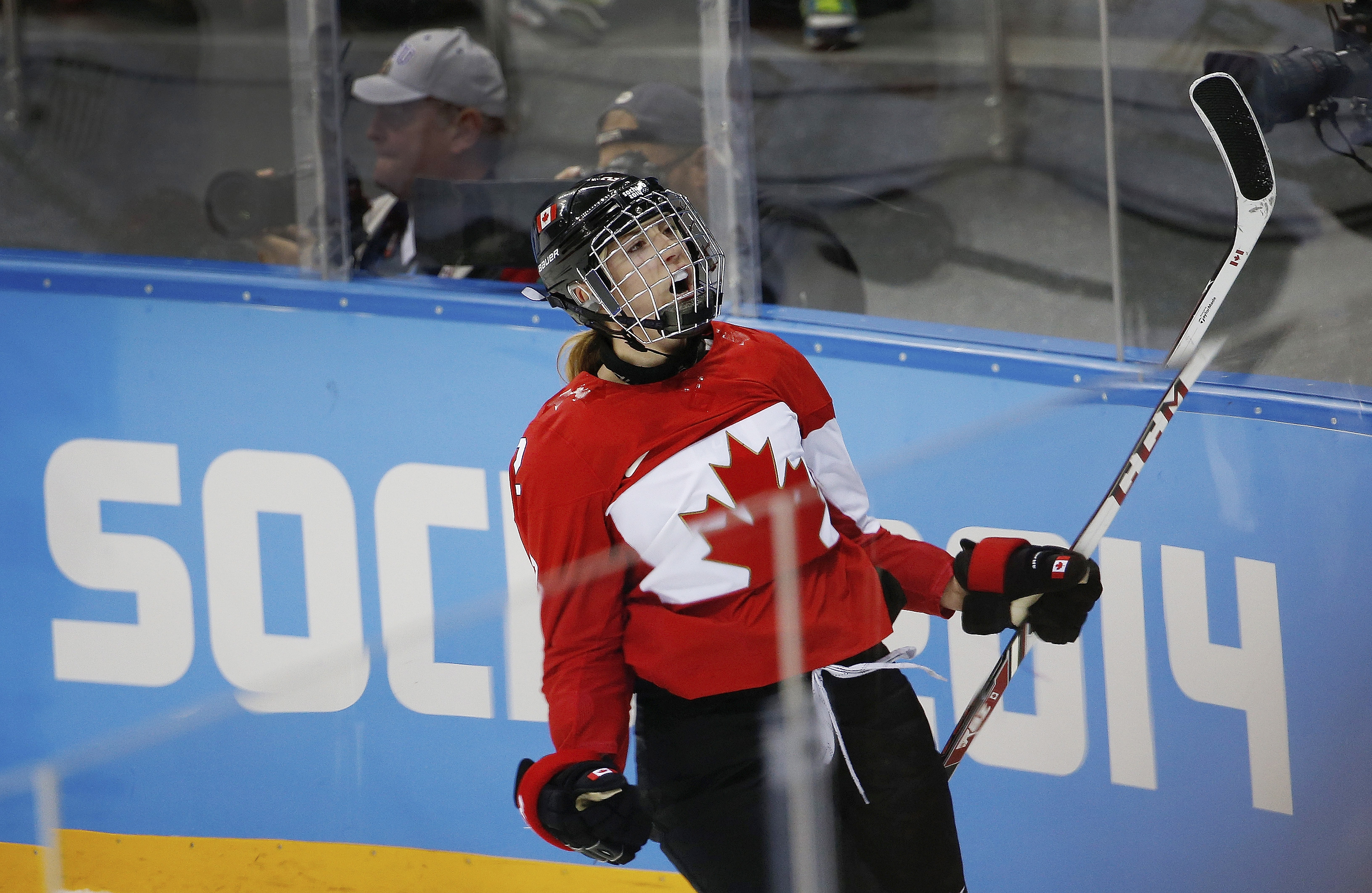 Meghan Agosta-Marciano of Canada celebrates her second goal against the United States during the third period of the 2014 Winter Olympics women's ice hockey game at Shayba Arena, Wednesday, Feb. 12, 2014, in Sochi, Russia. Canada defeated the Unites States 3-2. (AP Photo/Petr David Josek)