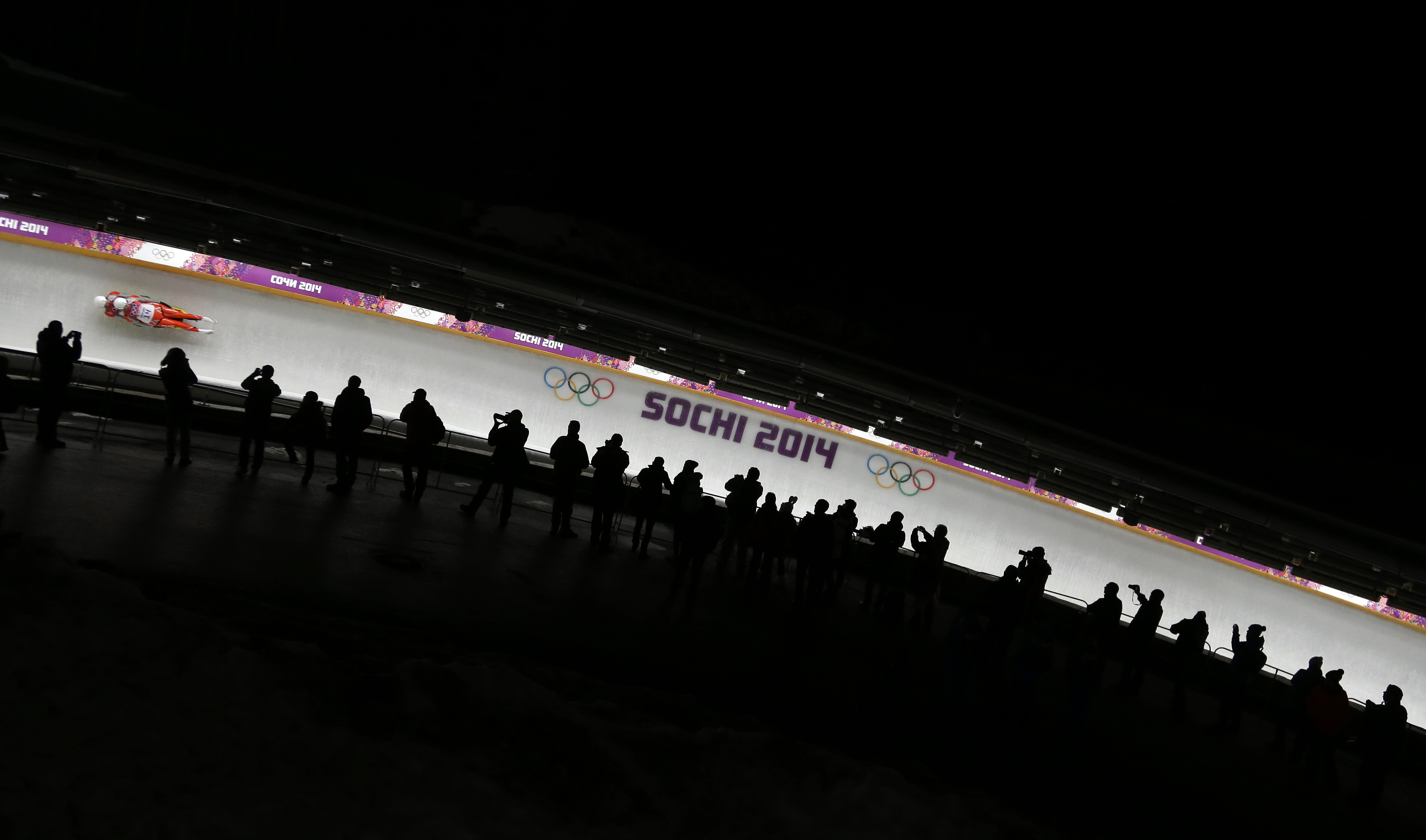 The doubles team of Patryk Poreba and Karol Mikrut of Poland race down the track in their final run during the men's doubles luge at the 2014 Winter Olympics, Wednesday, Feb. 12, 2014, in Krasnaya Polyana, Russia. (AP Photo/Natacha Pisarenko)