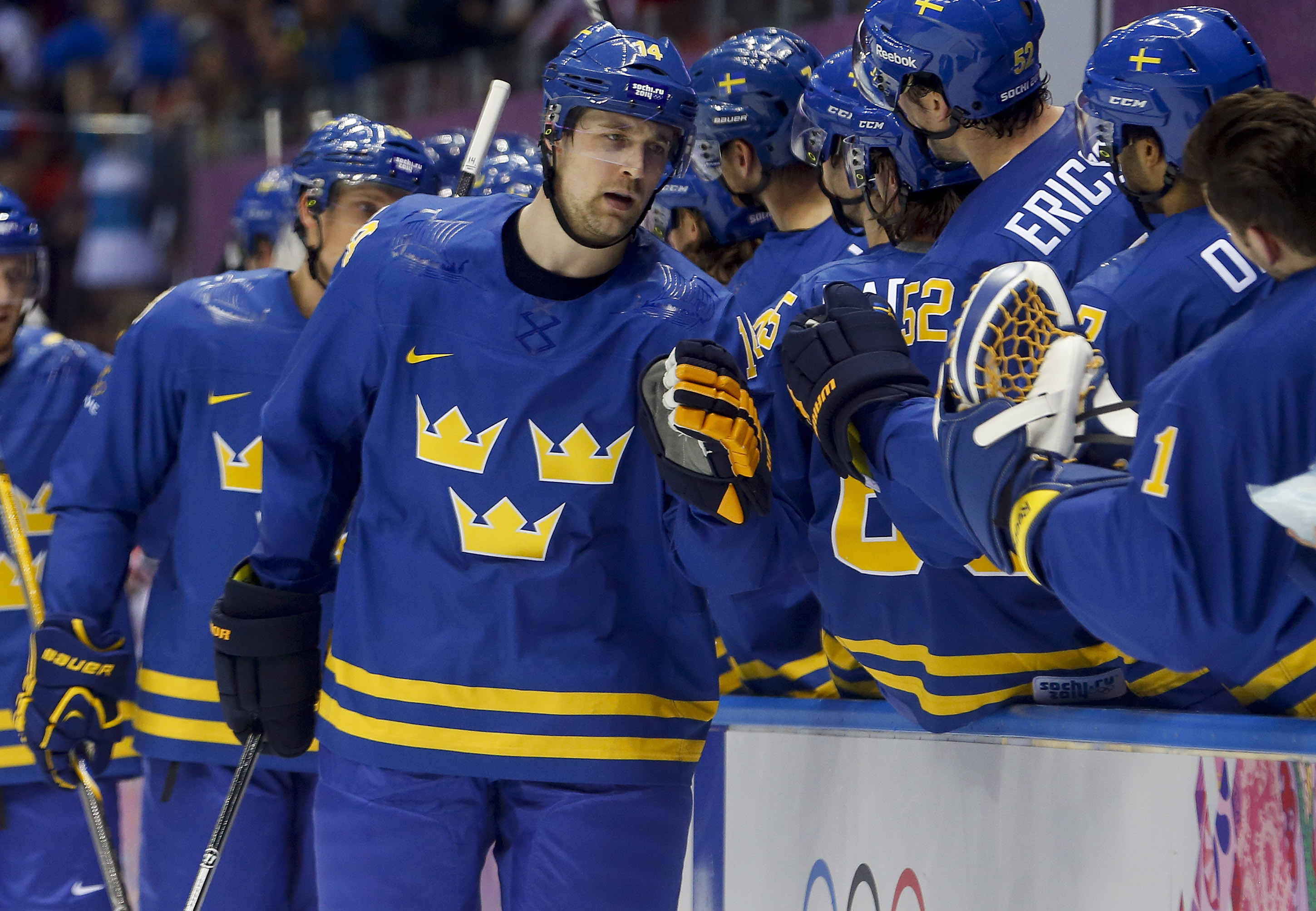 Sweden forward Patrik Berglund is congratulated by teammates after scoring a goal against the the Czech Republic in the first period of a men's ice hockey game at the 2014 Winter Olympics, Wednesday, Feb. 12, 2014, in Sochi, Russia. (AP Photo/Mark Humphrey)